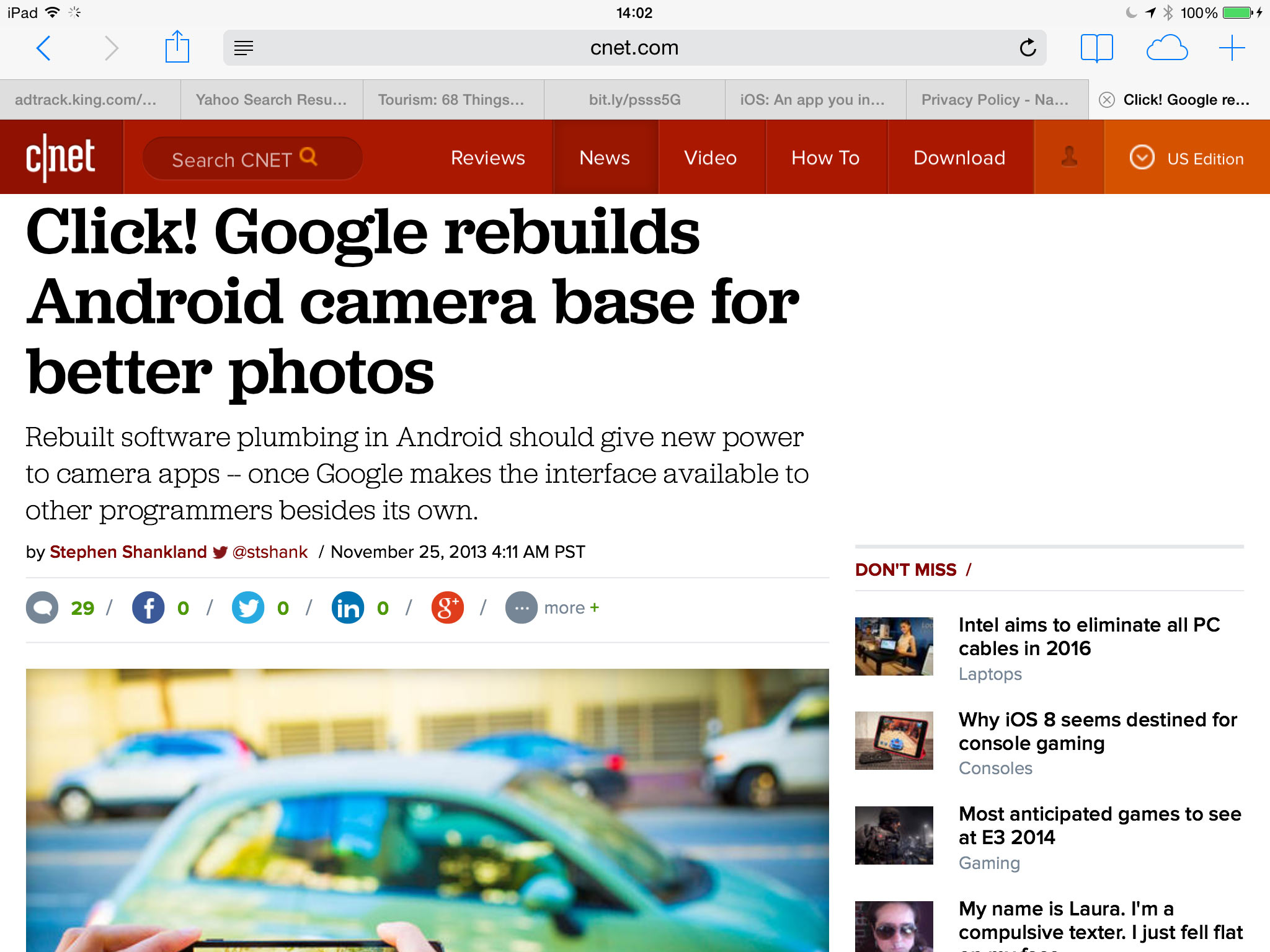 """Safari on an iPad with iOS 7 hides the full URL of this story, showing just """"cnet.com"""" as the Web address."""