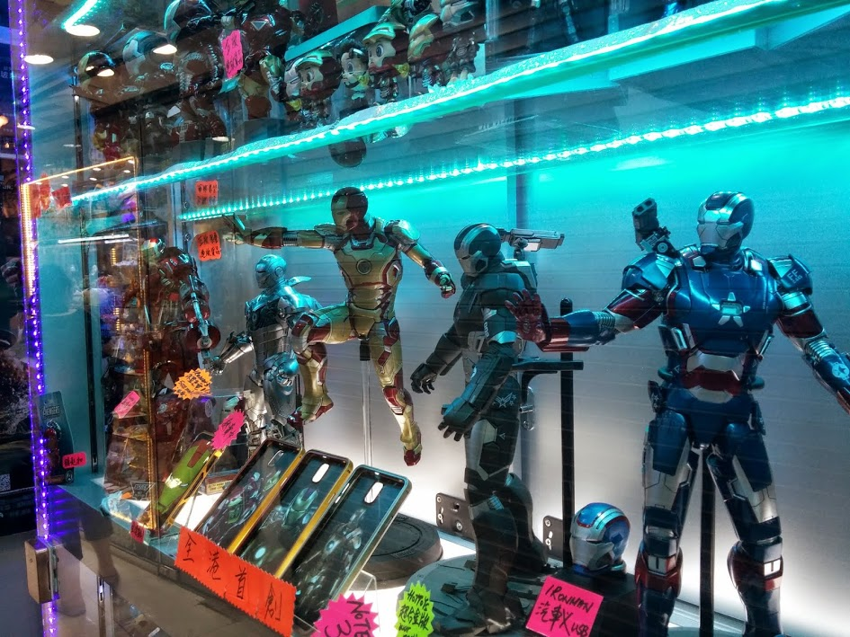 A full lineup of Iron Man figurines at a small store at Kwong Wa Street