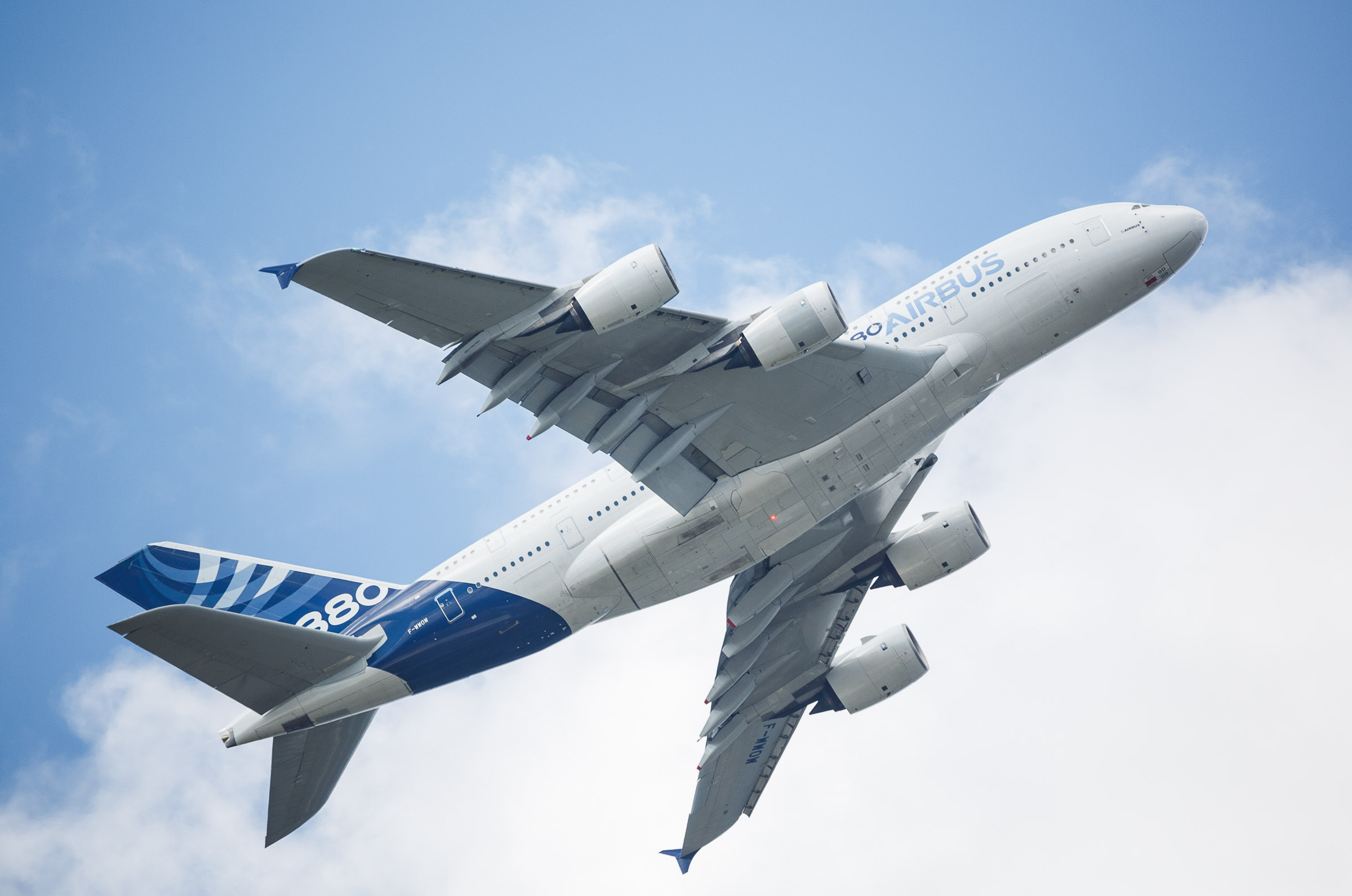 An Airbus A380-800 ascends steeply at the Farnborough International Airshow in the UK.