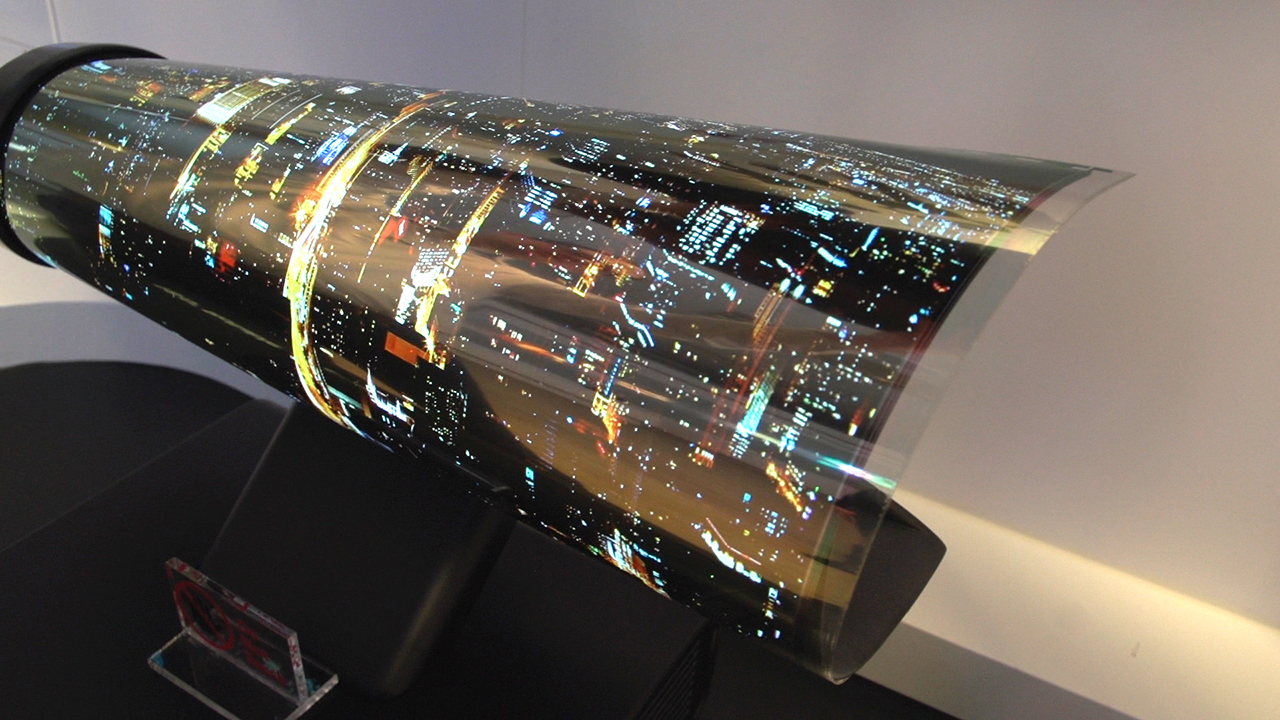 Video: LG OLED TV rolls up like a piece of paper