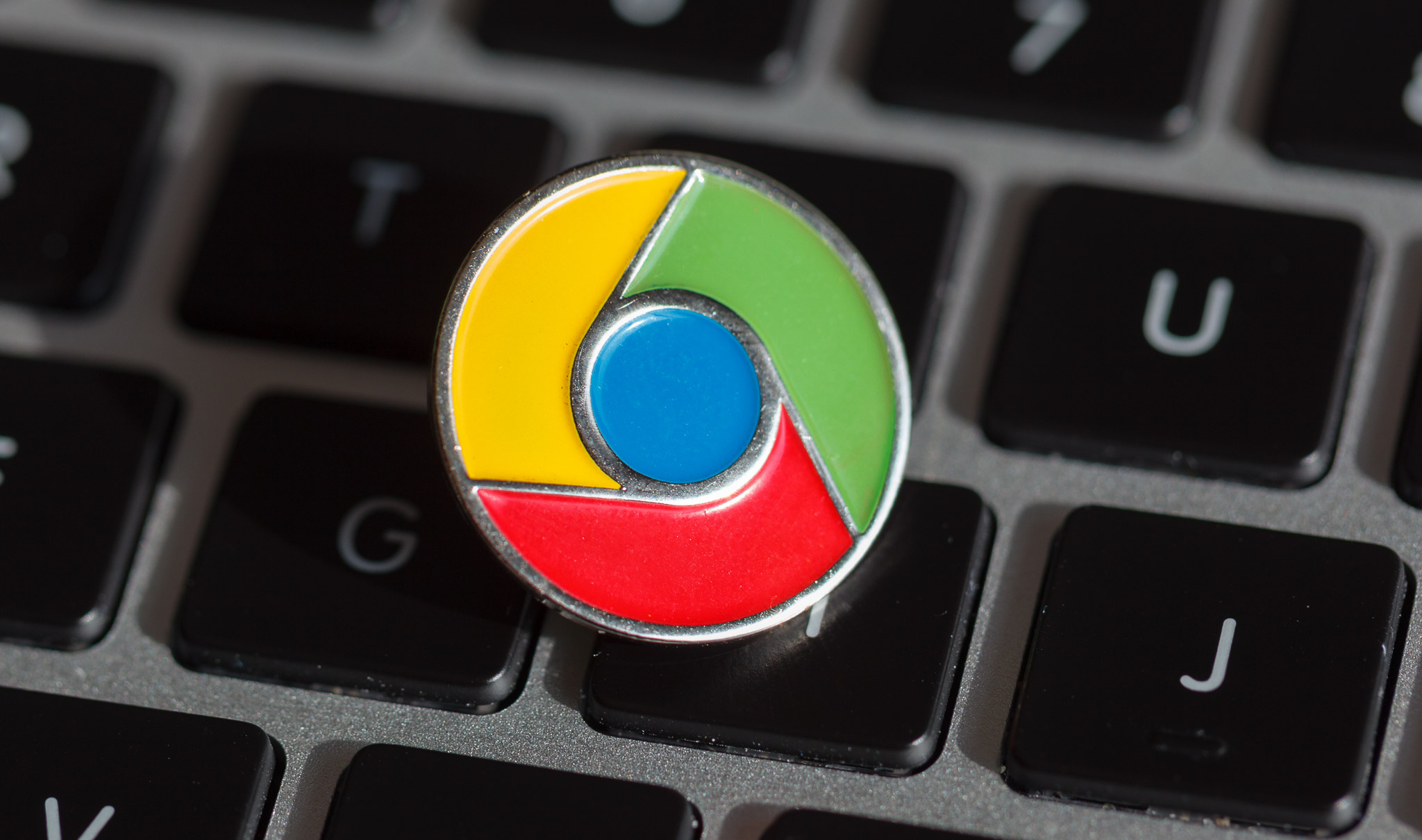 <p>A Google Chrome lapel pin</p>