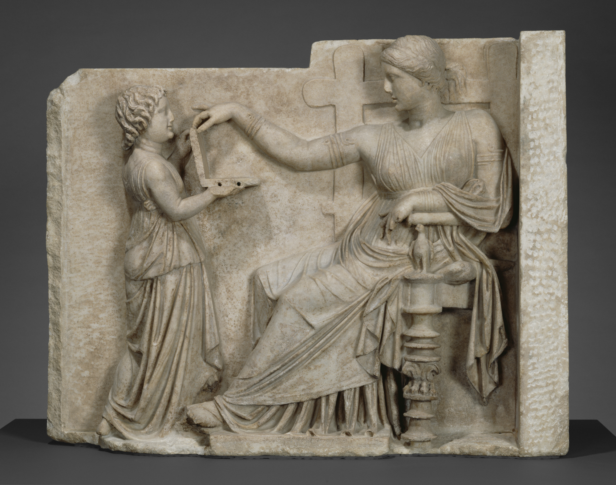 <p>This relief is an ancient Greek gravestone.</p>