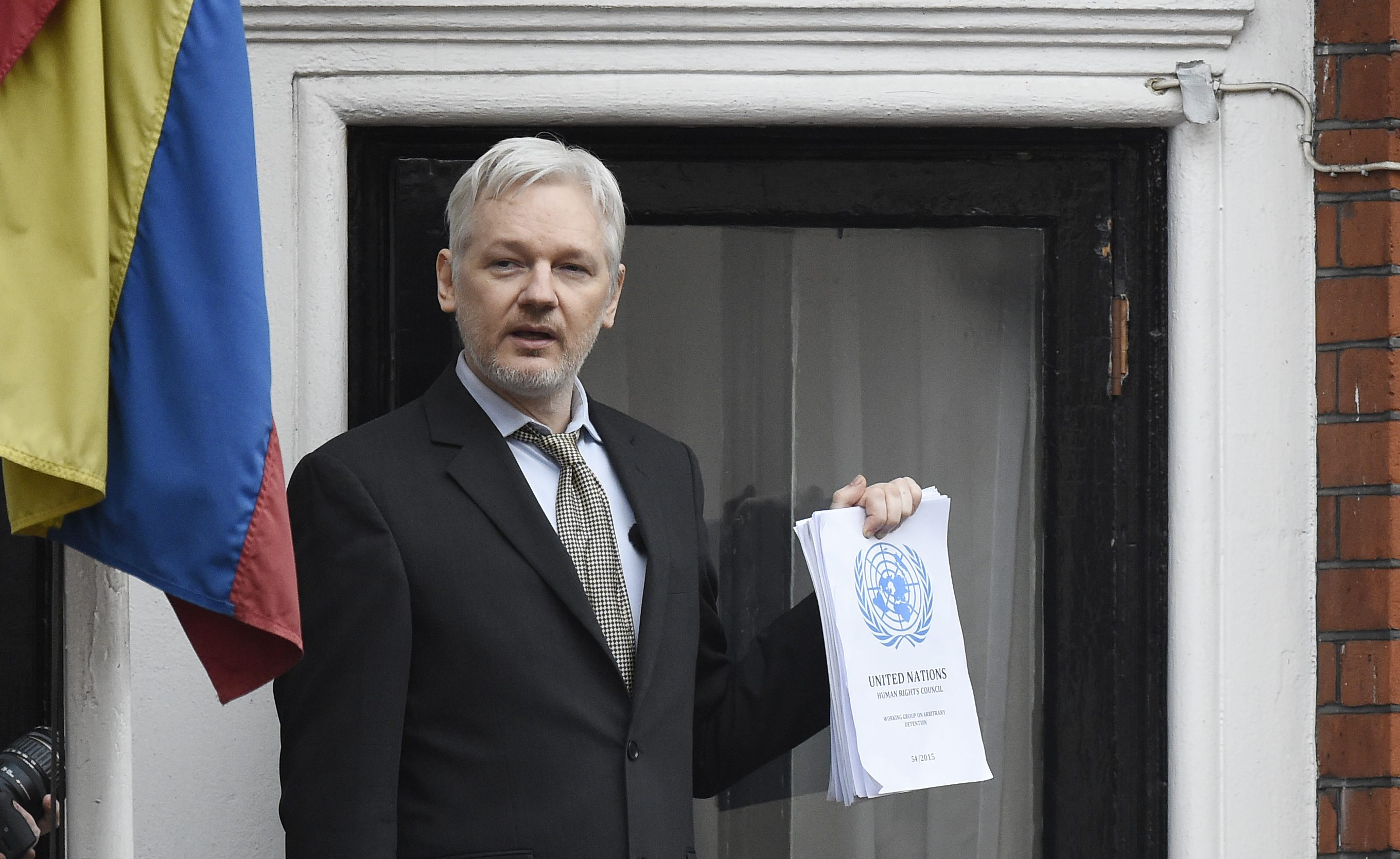 05 Feb 2016, London, England, UK --- epa05144885 WikiLeaks founder Julian Assange (C) speaks to the media from a balcony of the Ecuadorian Embassy in London, Britain, 05 February 2016. Assange hailed a UN panel's finding that he is under arbitrary detention on 05 February, urging Britain and Sweden to 'implement the decision.' Britain and Sweden have dismissed the ruling by the UN Working Group on Arbitrary Detention, a panel of independent legal scholars, that the Australian activist had been subject to arbitrary detention since his arrest in London in 2010 on Swedish allegations of rape and sexual harassment. Although the ruling is legally binding, the panel has no power to enforce it, and their decision was quickly dismissed by Britain and Sweden. EPA/FACUNDO ARRIZABALAGA --- Image by © FACUNDO ARRIZABALAGA/epa/Corbis