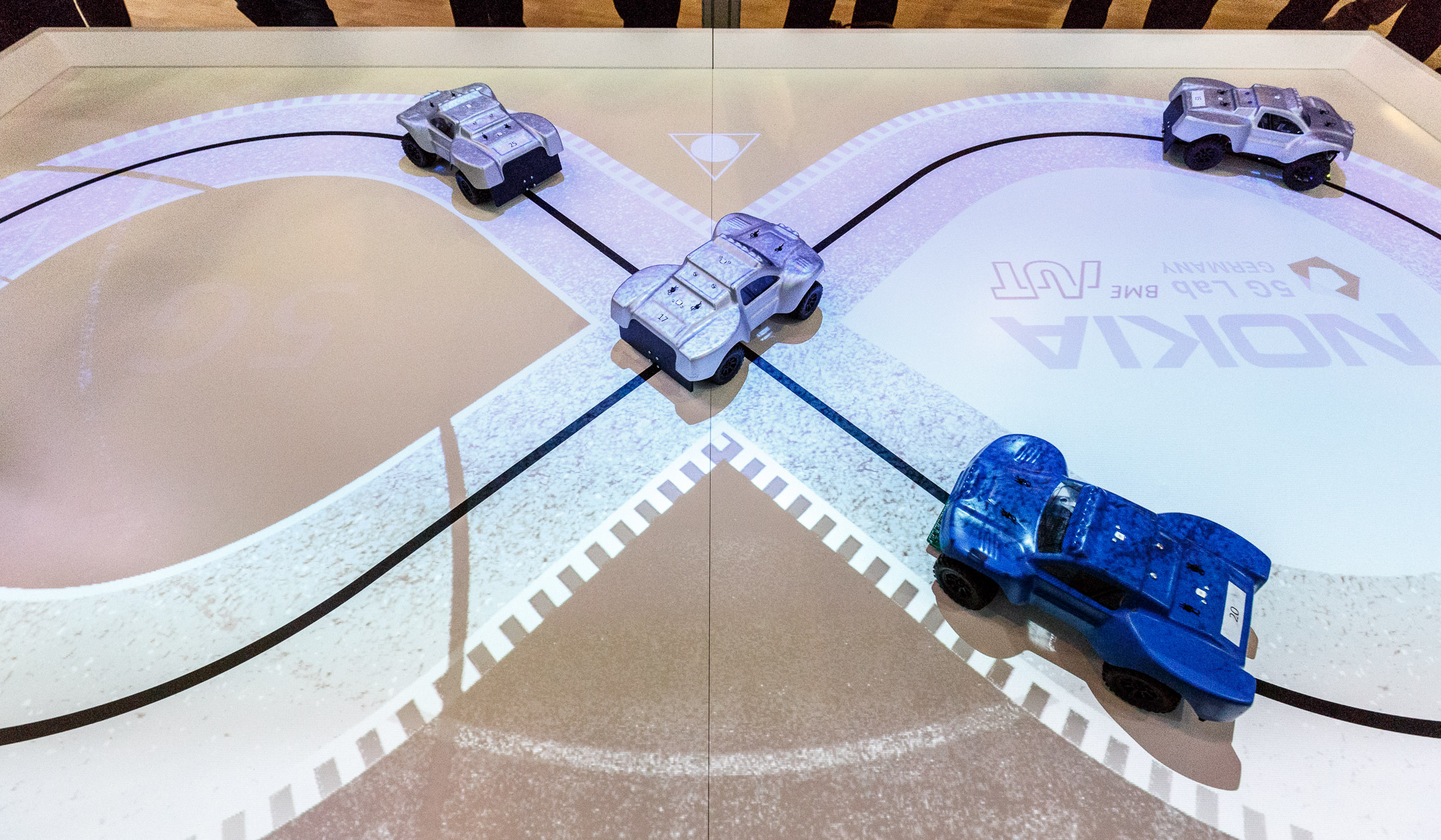 Nokia​ demonstrates how 5G networks are fast enough to coordinate toy cars whizzing through an intersection without colliding.