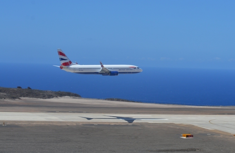 <p>A Comair 737 passes over Saint Helena's airport on a test flight. Comair is subsidiary of British Airways.</p>