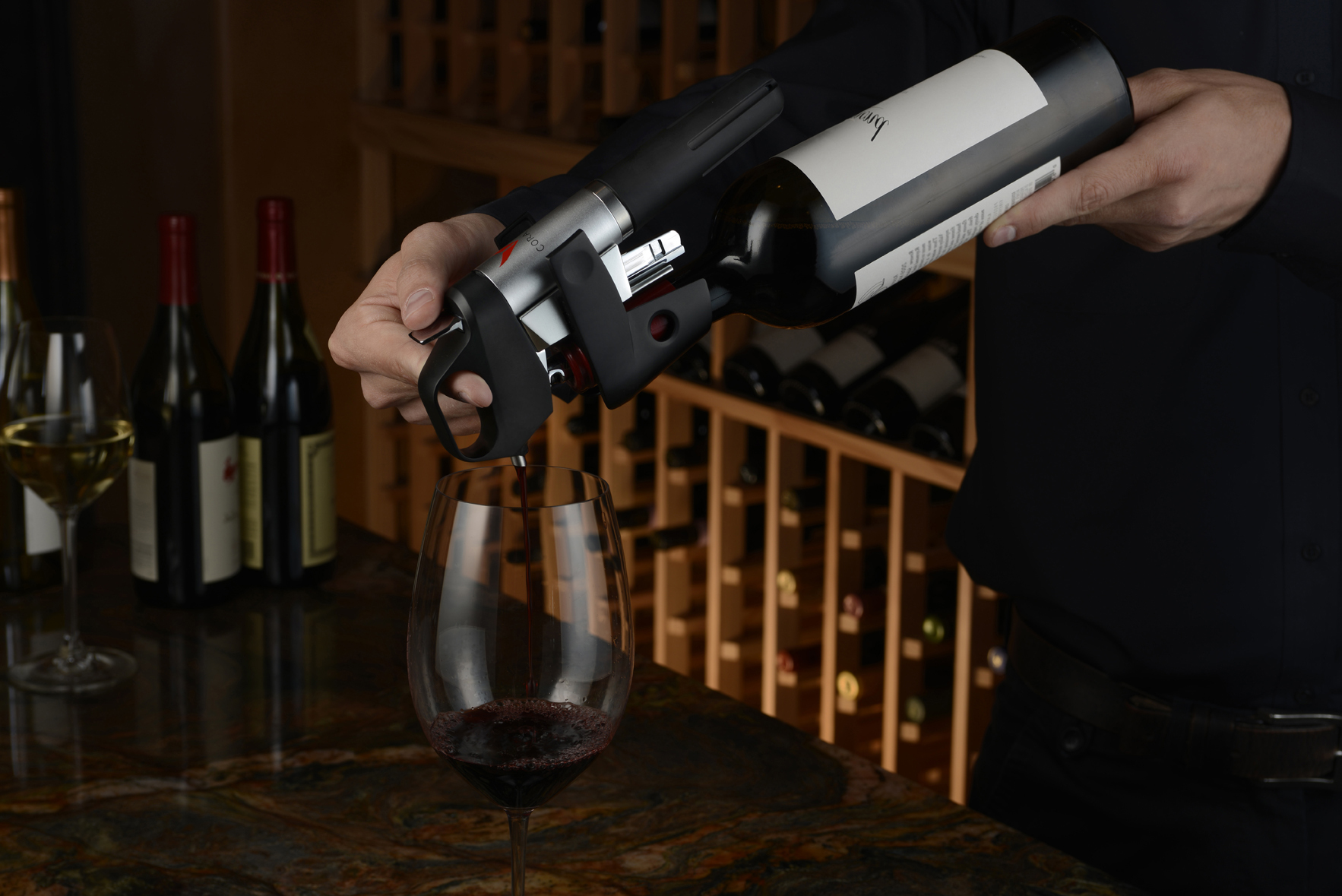 The Coravin 1000 System pulls wine out of a bottle as easily as it is to make it disappear.