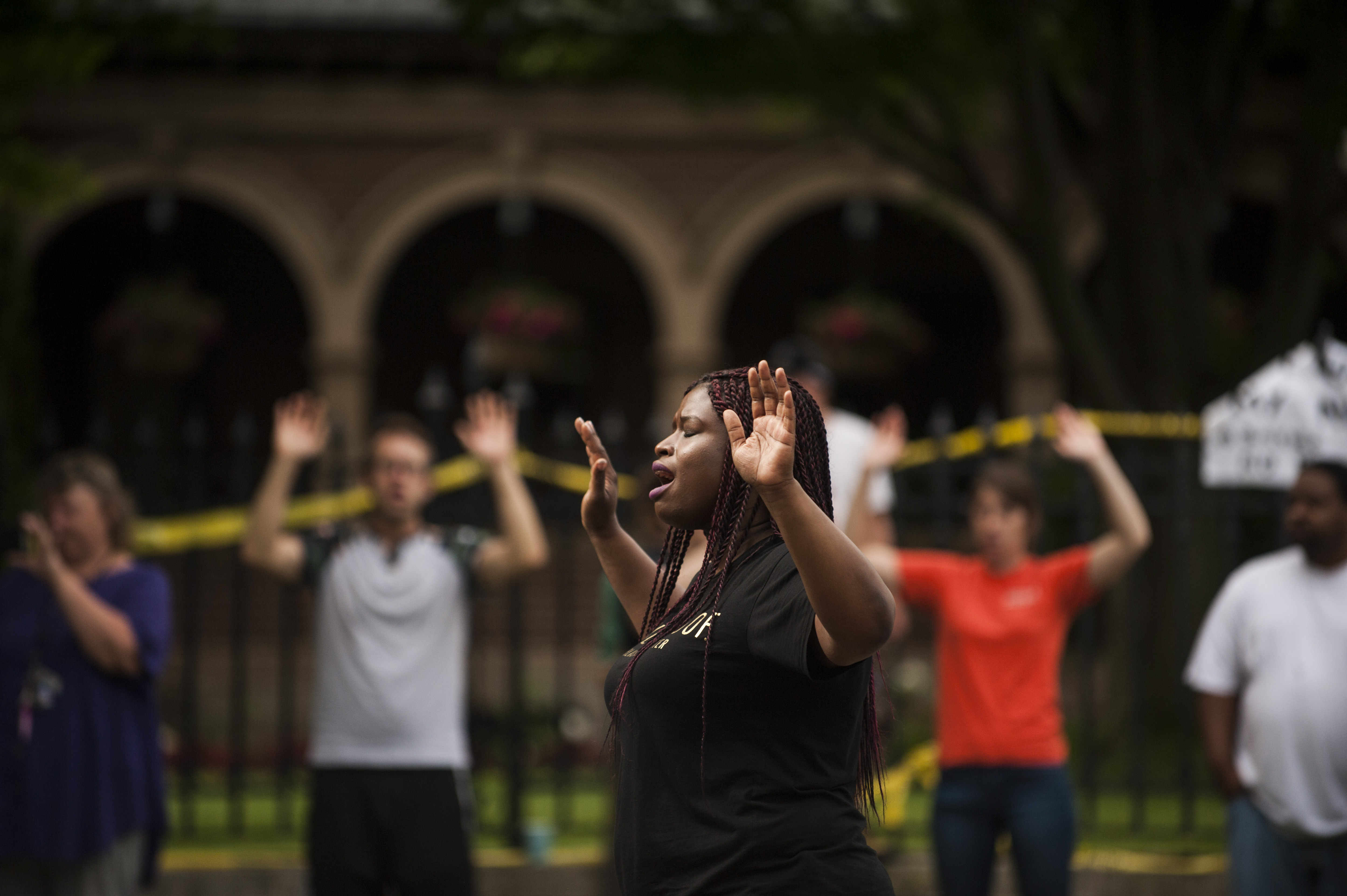 """Minneapolis NAACP President Nekima Levy-Pounds leads a chant of """"Hands up, don't shoot"""" outside the Minnesota governor's mansion one day after Philando Castile's death."""