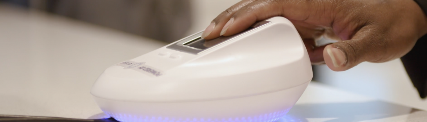 guest-places-fingers-on-scanner