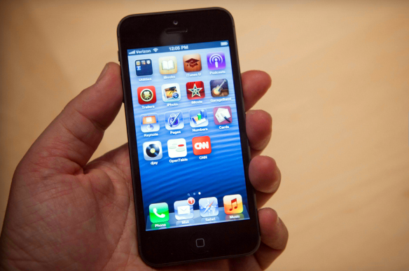 The iPhone 5 in hand.