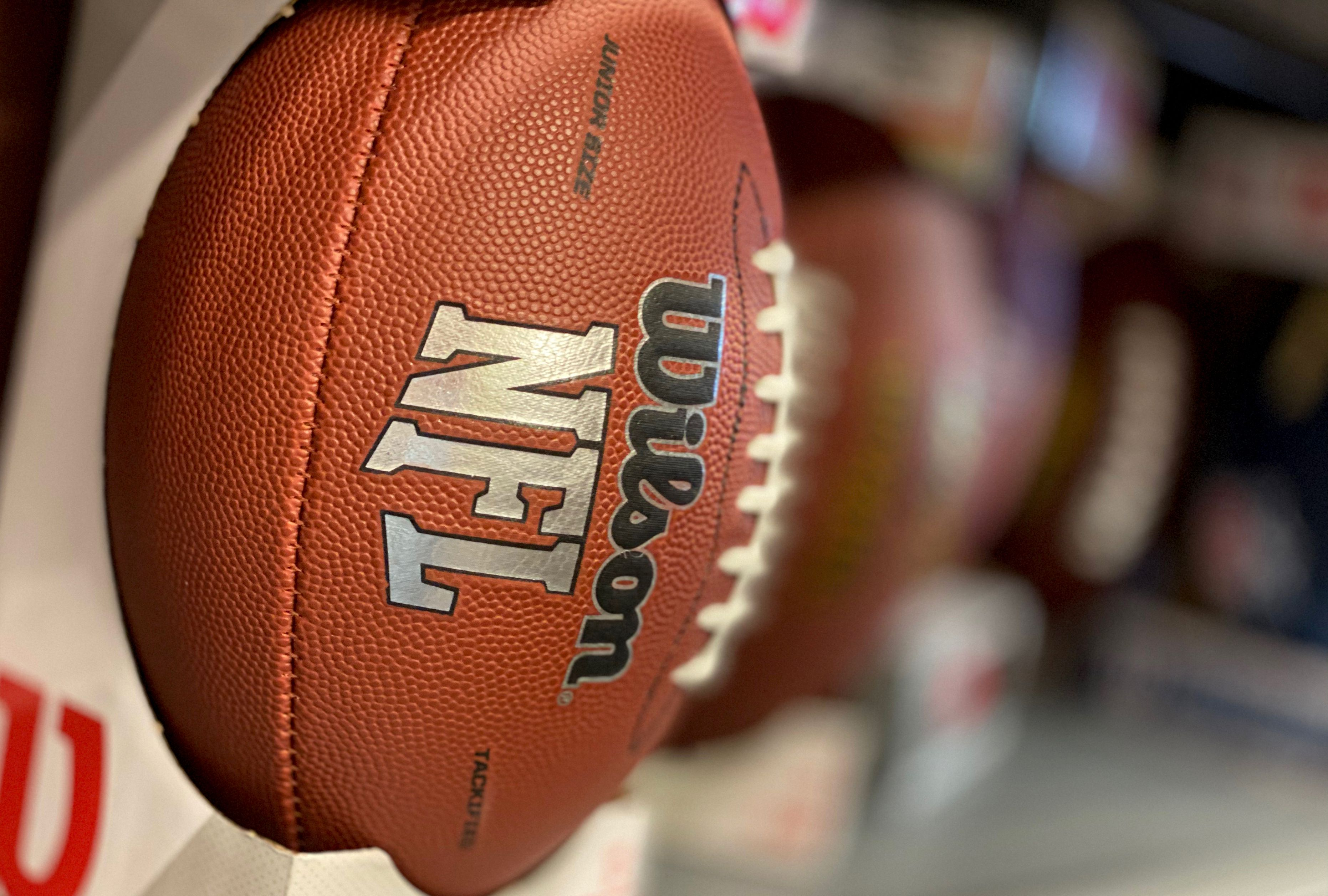 A football is seen displayed in a sports store in Culver City.