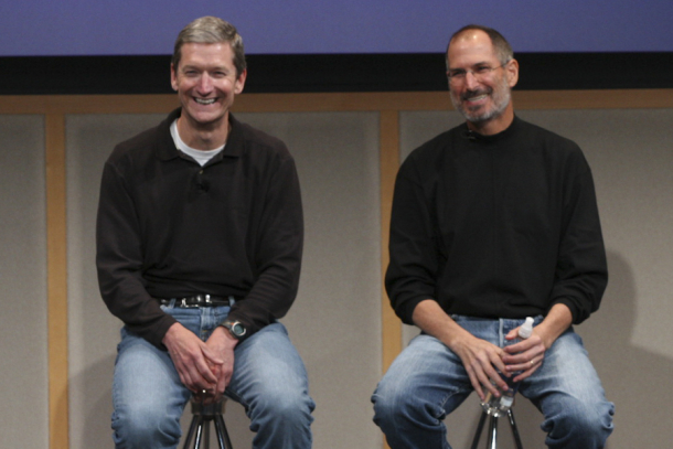 Apple CEO Tim Cook sitting at Steve Jobs' right at an event in 2007.