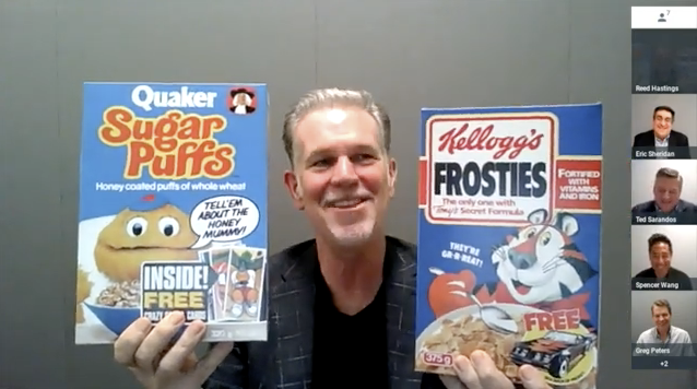 Reed Hastings holds up two different boxes of cereal