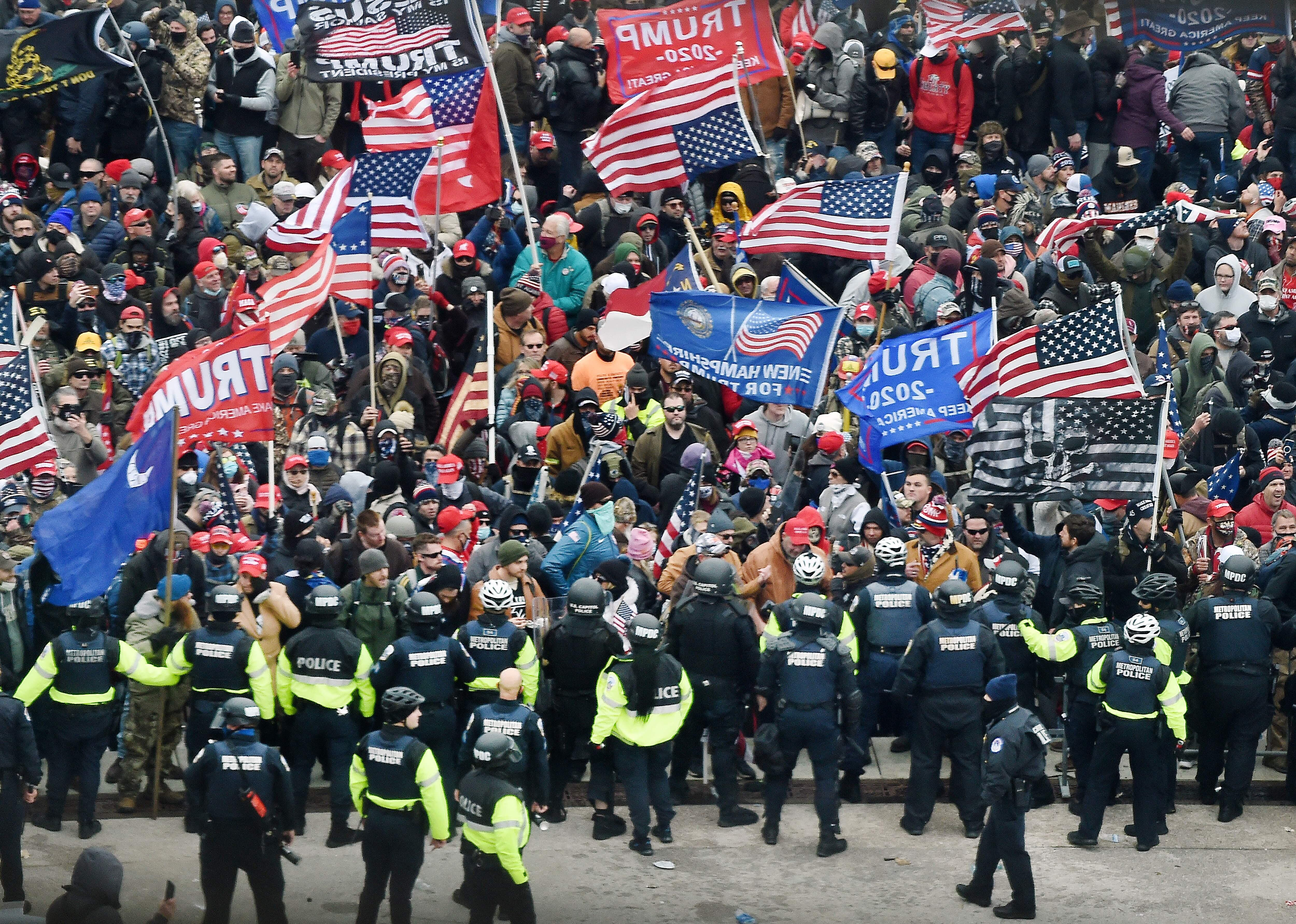 <p>President Donald Trump's supporters clash with police and security forces as they storm the US Capitol in Washington, DC on January 6, 2021.</p>