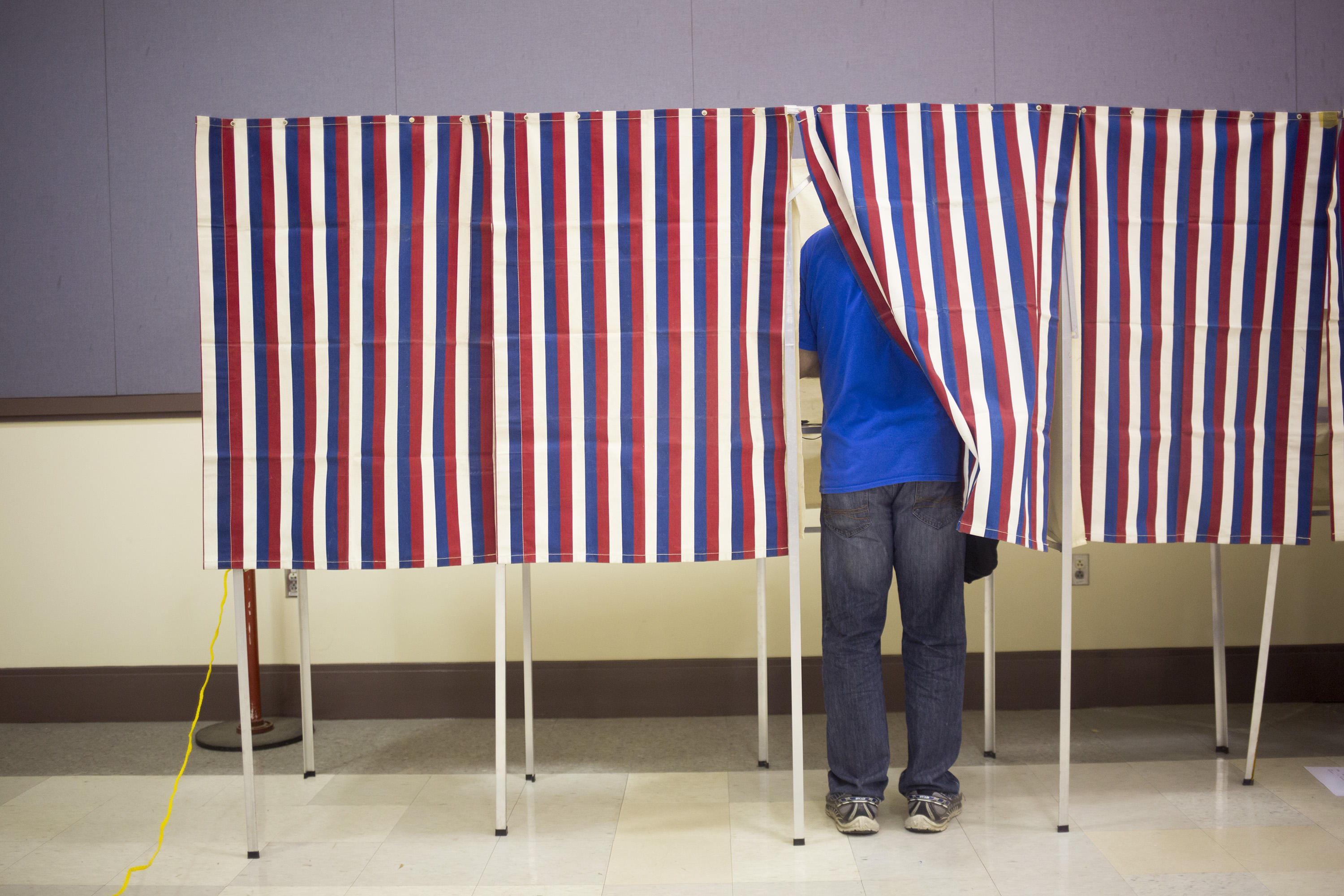 Maine voter in a voting booth on November 8, 2016