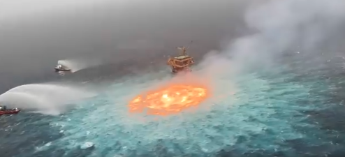 Boats work to extinguish fire in the Gulf of Mexico