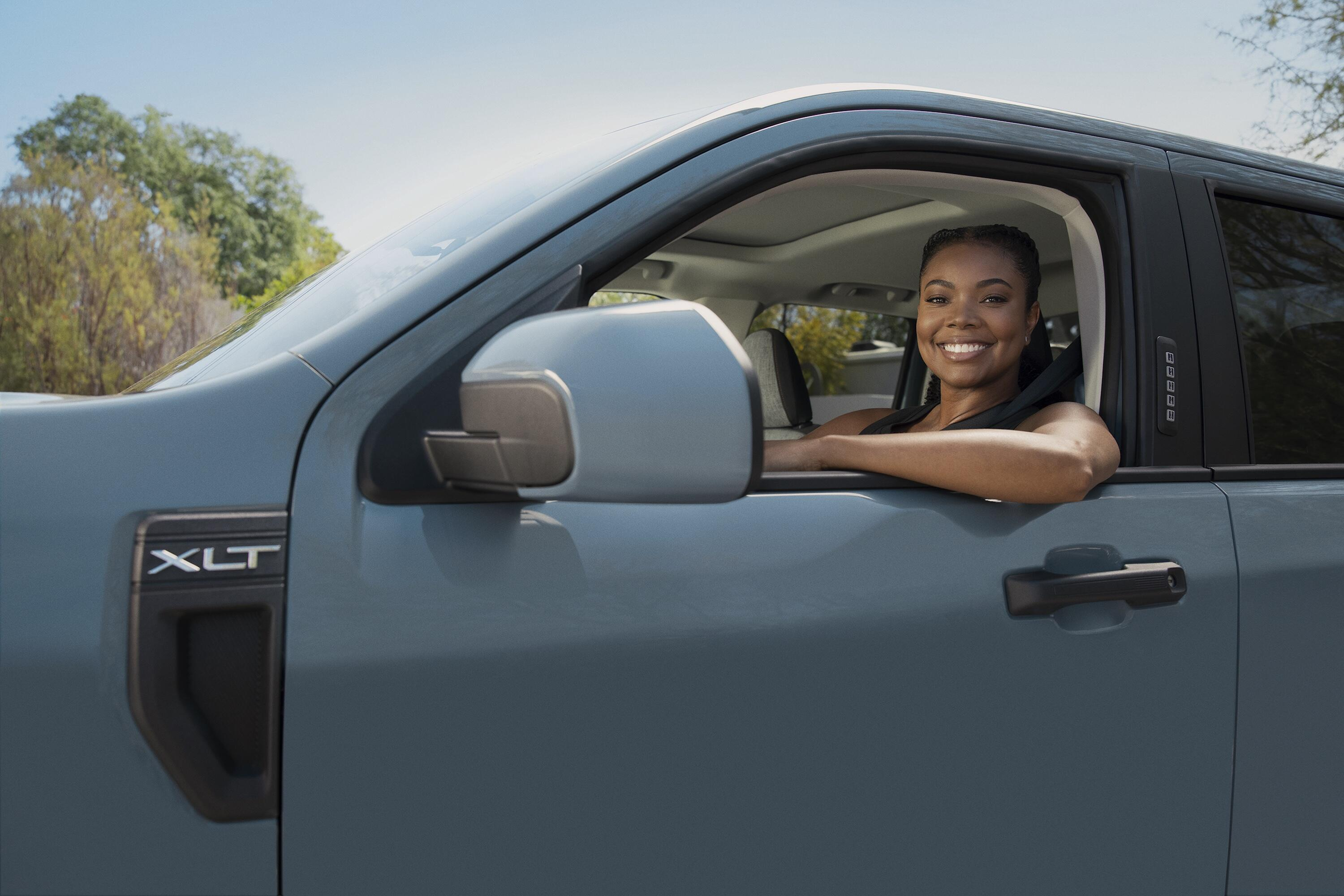 Gabrielle Union sitting in a 2022 Ford Maverick pickup