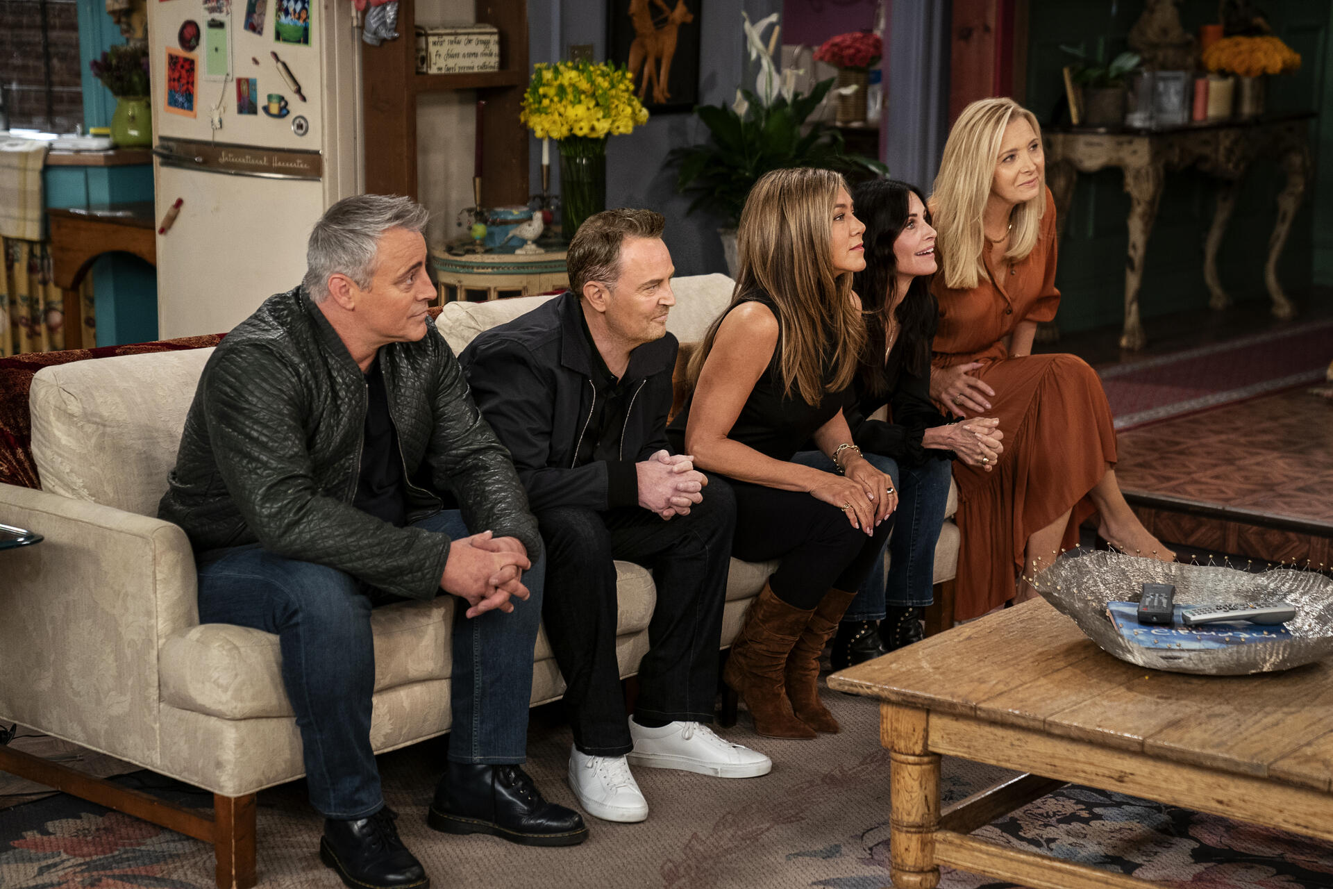 Friends cast sitting on couch during reunion