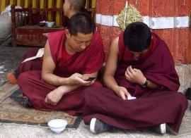 novice-monks-texting-small270x196.jpg