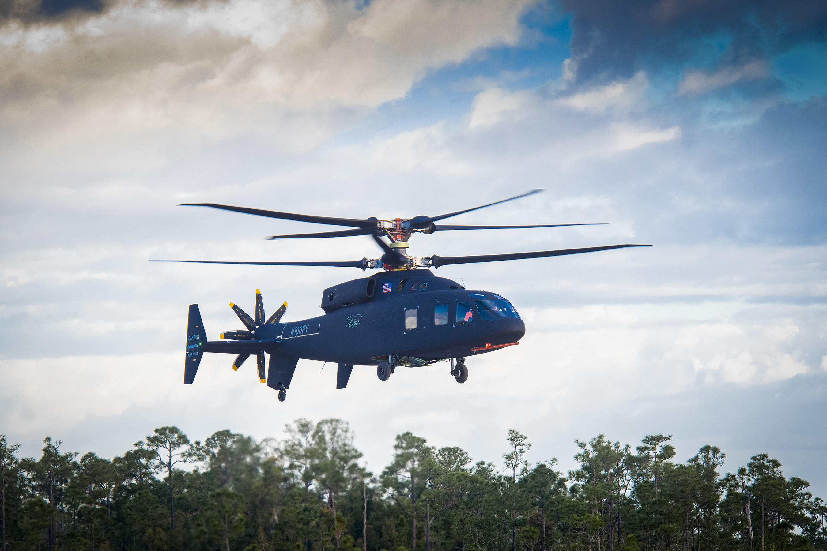 The Sikorsky-Boeing SB1 Defiant helicopter makes its first flight.