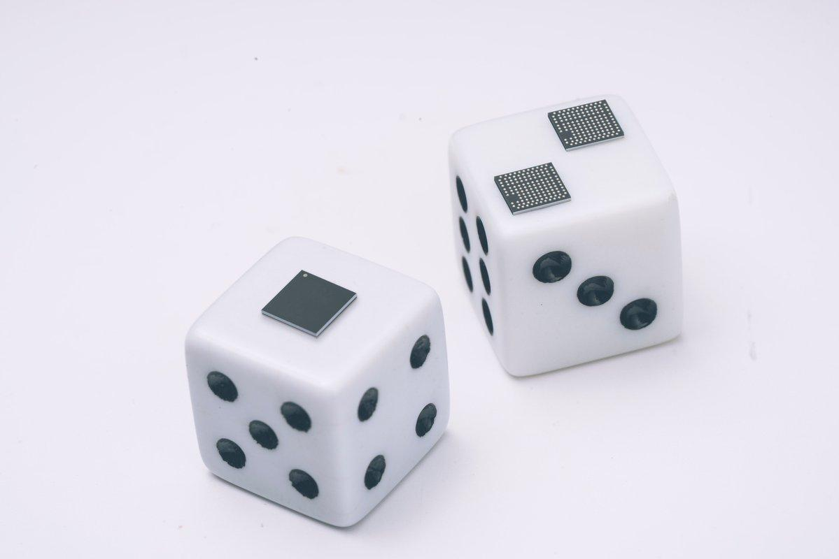 Google's tiny tensor processing unit (TPU) chips are shown perched on a pair of dice.