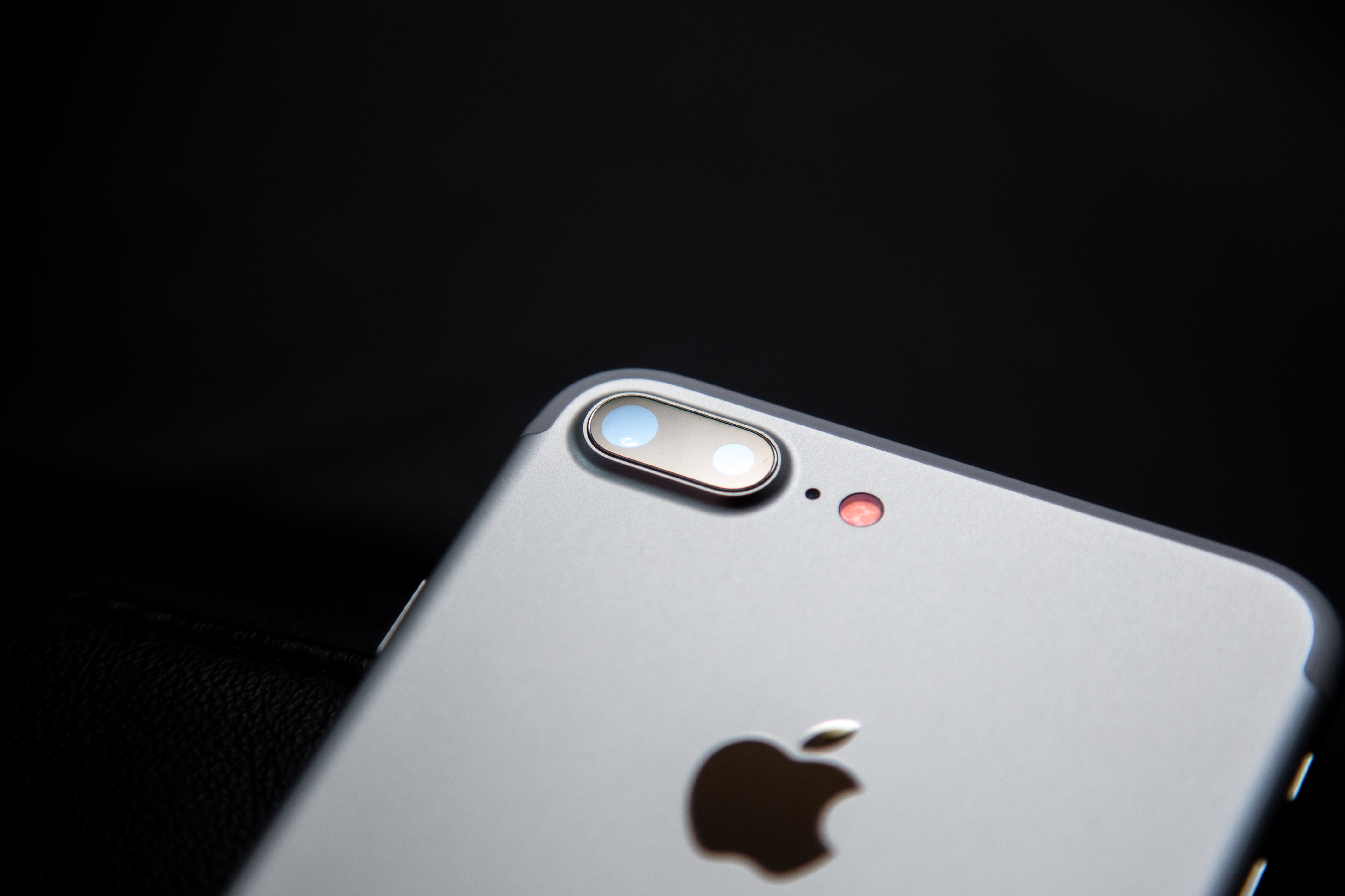 """A close-up of an iPhone camera lens. iPhone users found they could find their semi-nude photos by searching the term """"brassiere."""""""