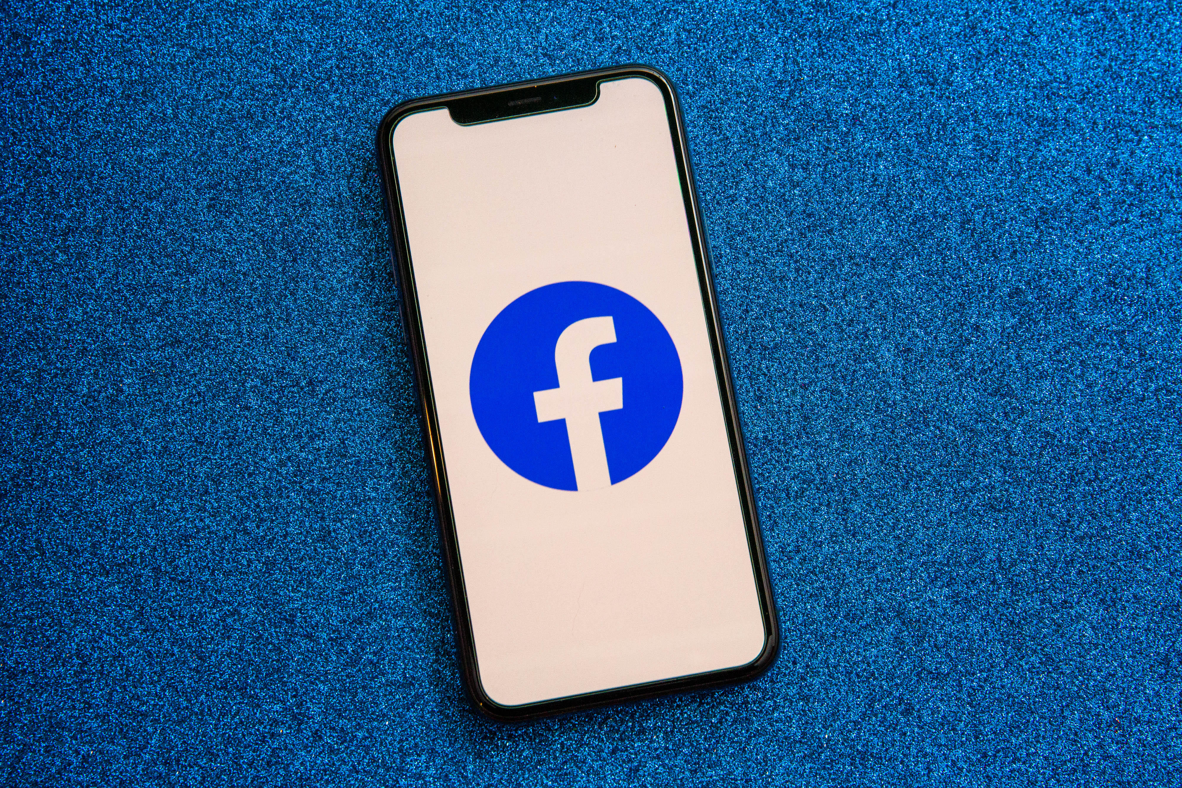 001-facebook-app-logo-on-phone-2021