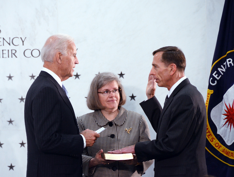 Former CIA director David Petraeus, right, being sworn in by Vice President Joe Biden, left,  with his wife at his side, middle.