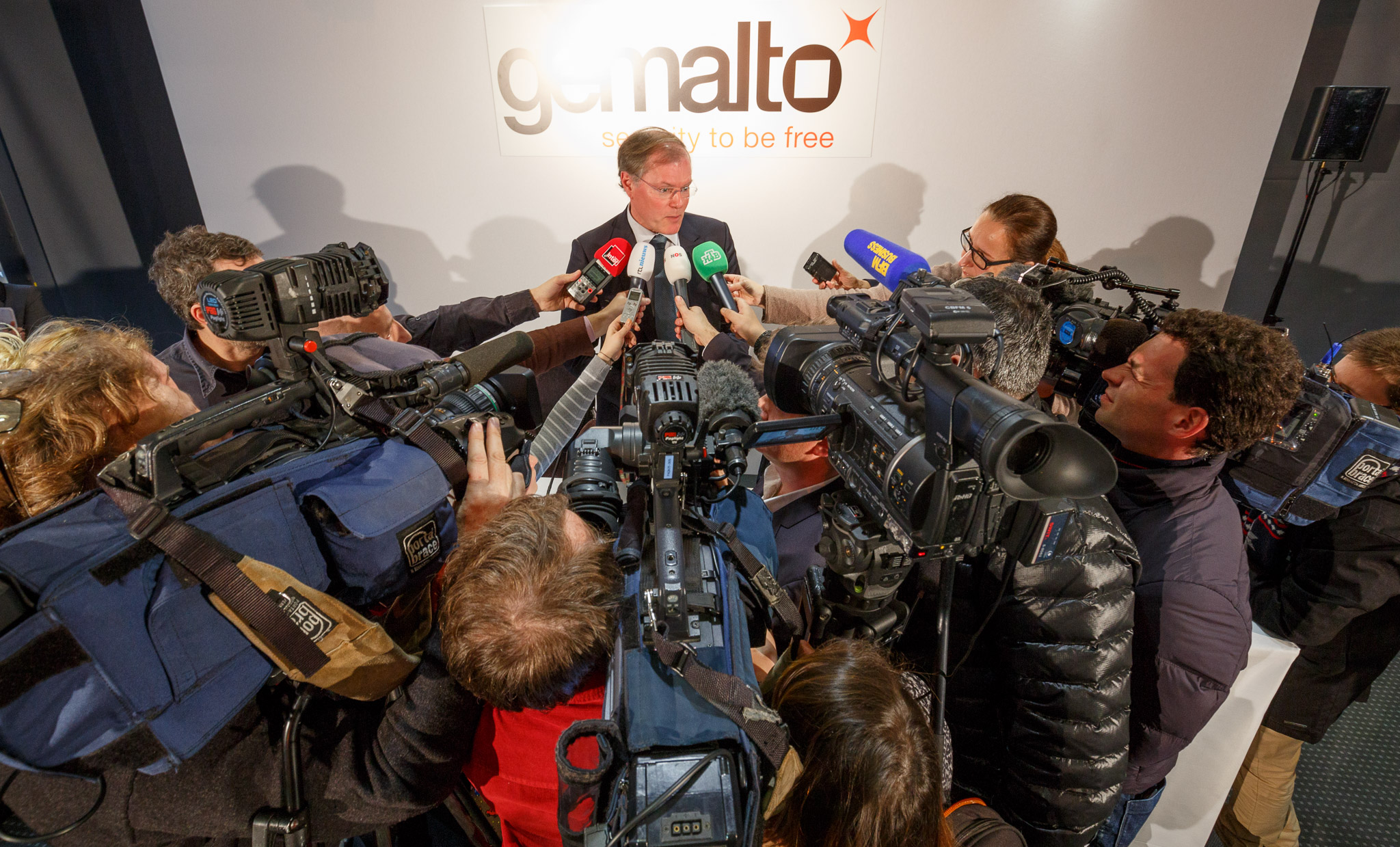 Gemalto Chief Executive Olivier Piou answers questions about SIM card key theft attempts at a Paris news conference.