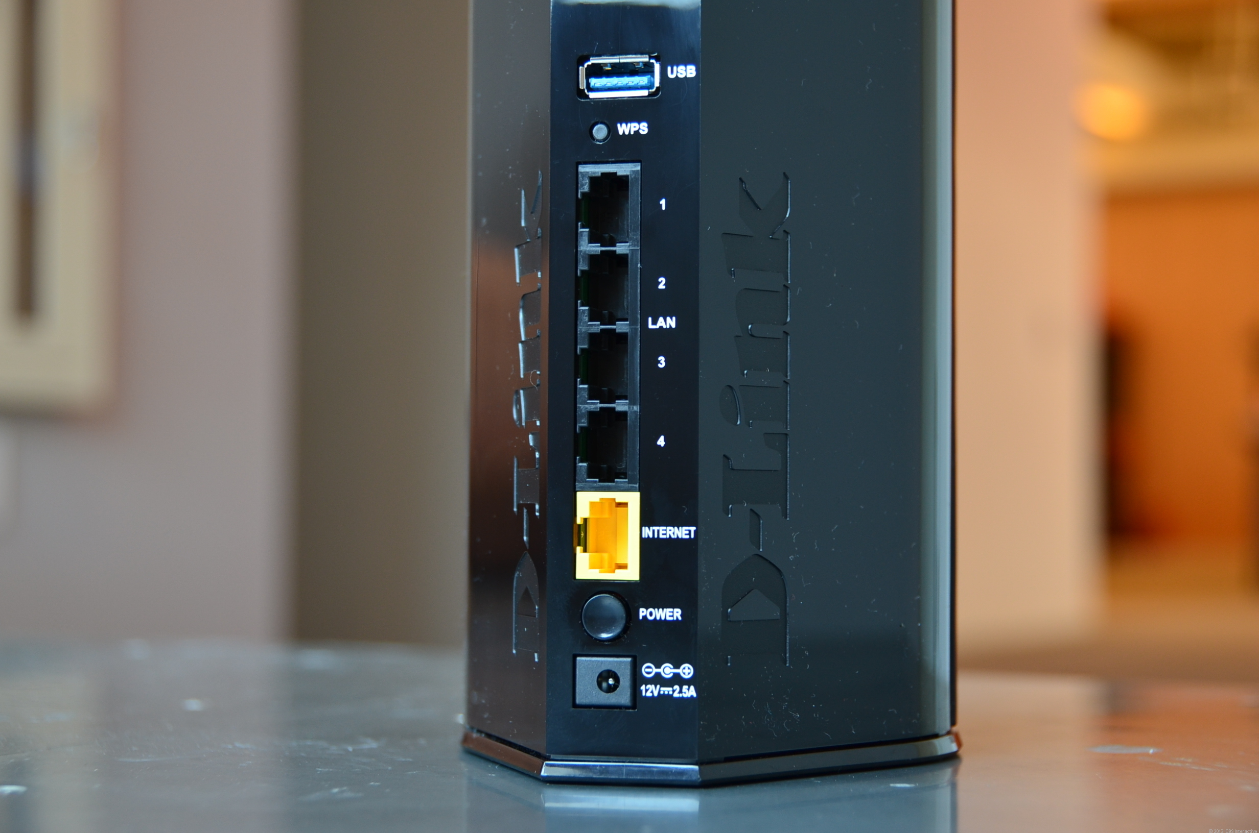 The cylindrical DIR-868L comes with four gigabit LAN ports, one gigabit WAN port, and a USB 3.0 port.