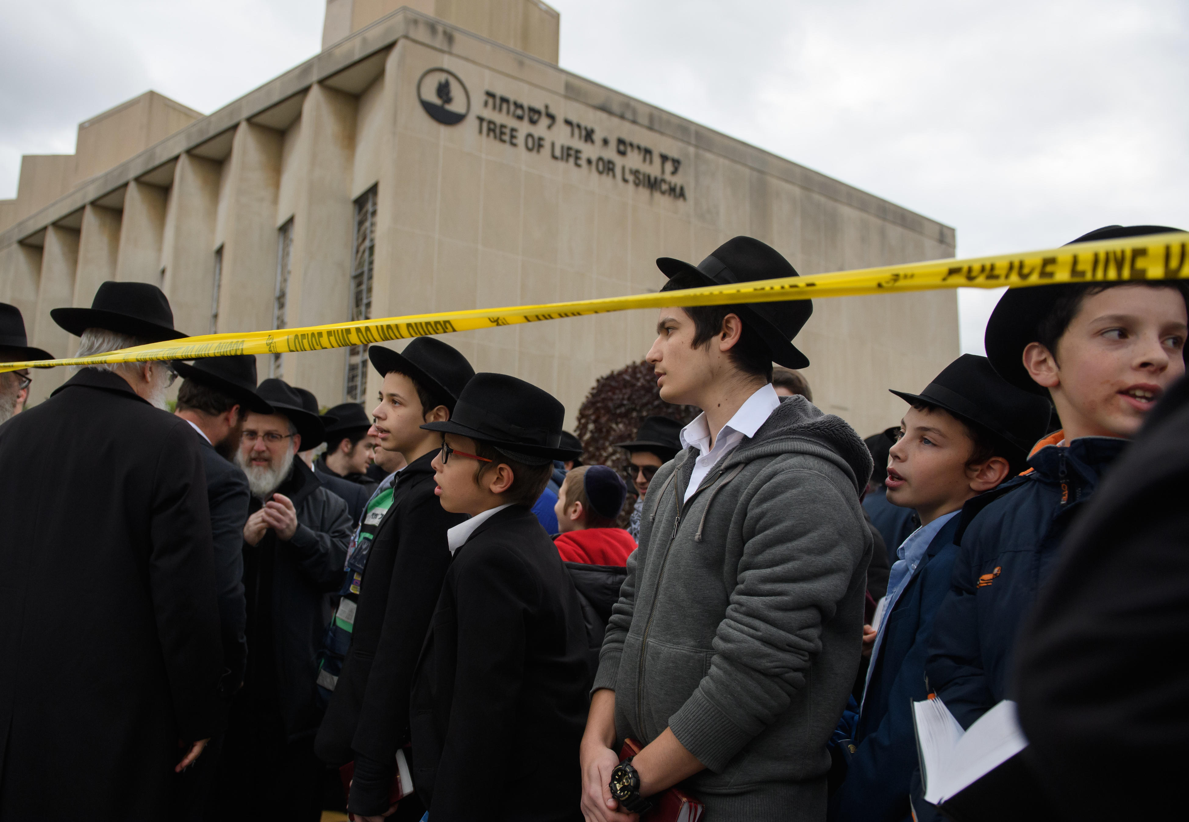 <p>Orthodox Jews gather to hold a prayer session Monday afternoon at the site of the mass shooting that killed 11 people and wounded 6 at the Tree Of Life Synagogue on October 29, 2018 in Pittsburgh, Pennsylvania. Eleven people were killed and six more wounded in the mass shooting that police say was fueled by antisemitism.</p>