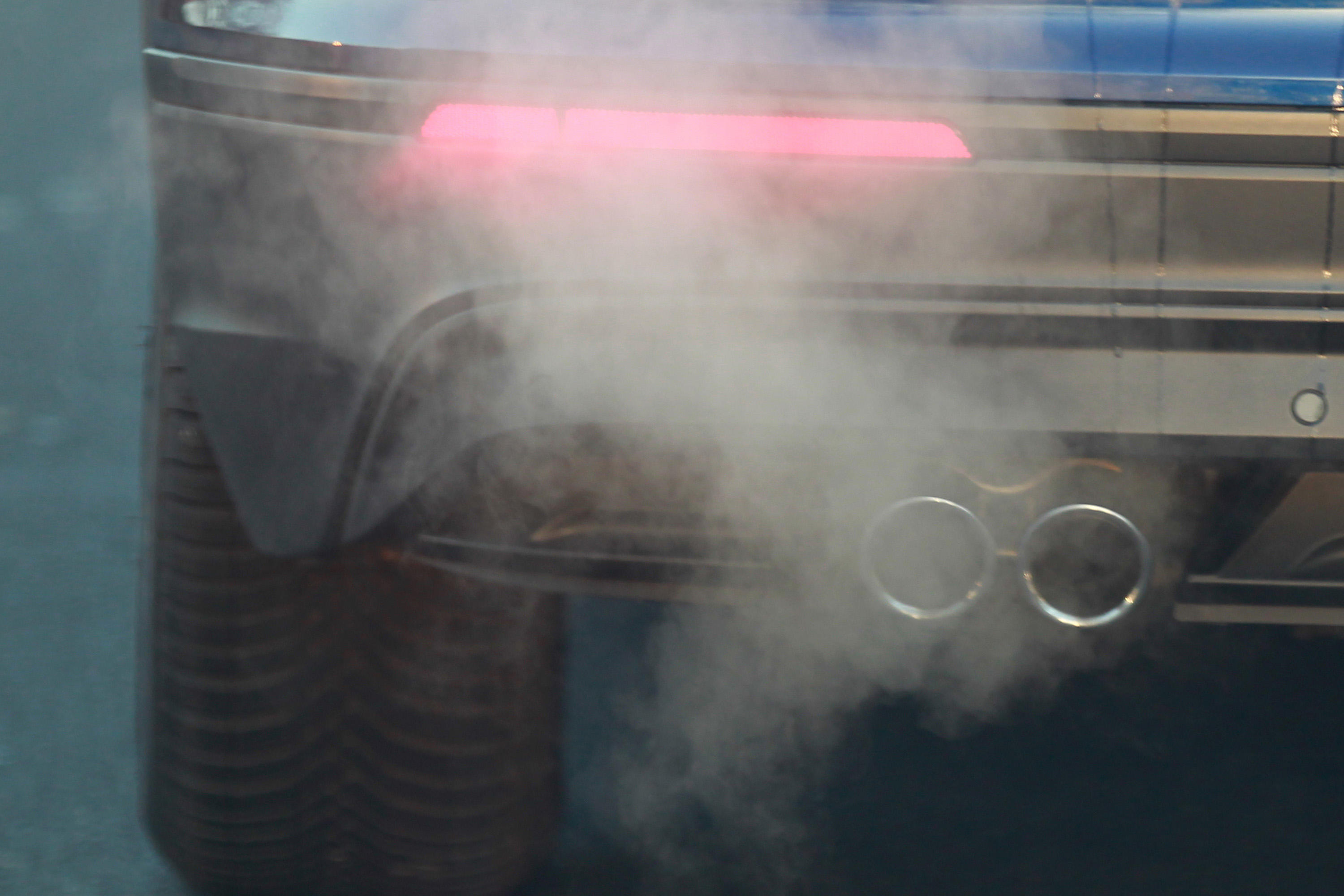 A car seen emitting exhaust fumes on the Street In Cologne.