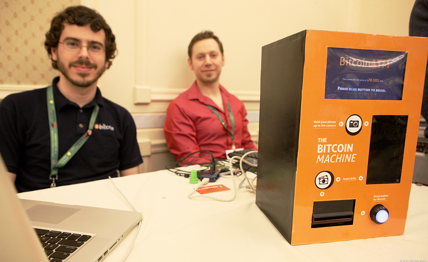 Zach Harvey, right, and Matt Whitlock created this ATM that accepts dollar bills and converts it to the alternative Bitcoin currency.