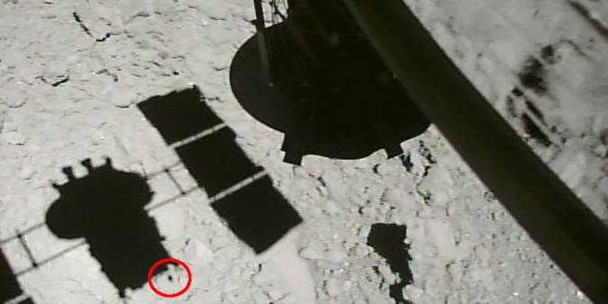The shadow of the Hayabusa2 spacecraft on the surface of the asteroid Ryugu.