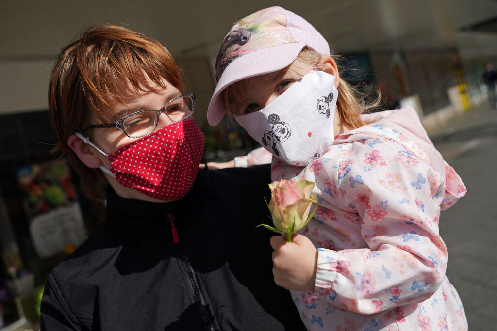 A mother and daughter in Berlin wear homemade face masks. The US Centers for Disease Control and Prevention now recommends that people in the states wear nonmedical, cloth face masks when they venture out.