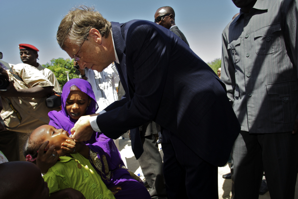 Bill Gates administers an oral vaccine to a child during a recent trip to Chad.