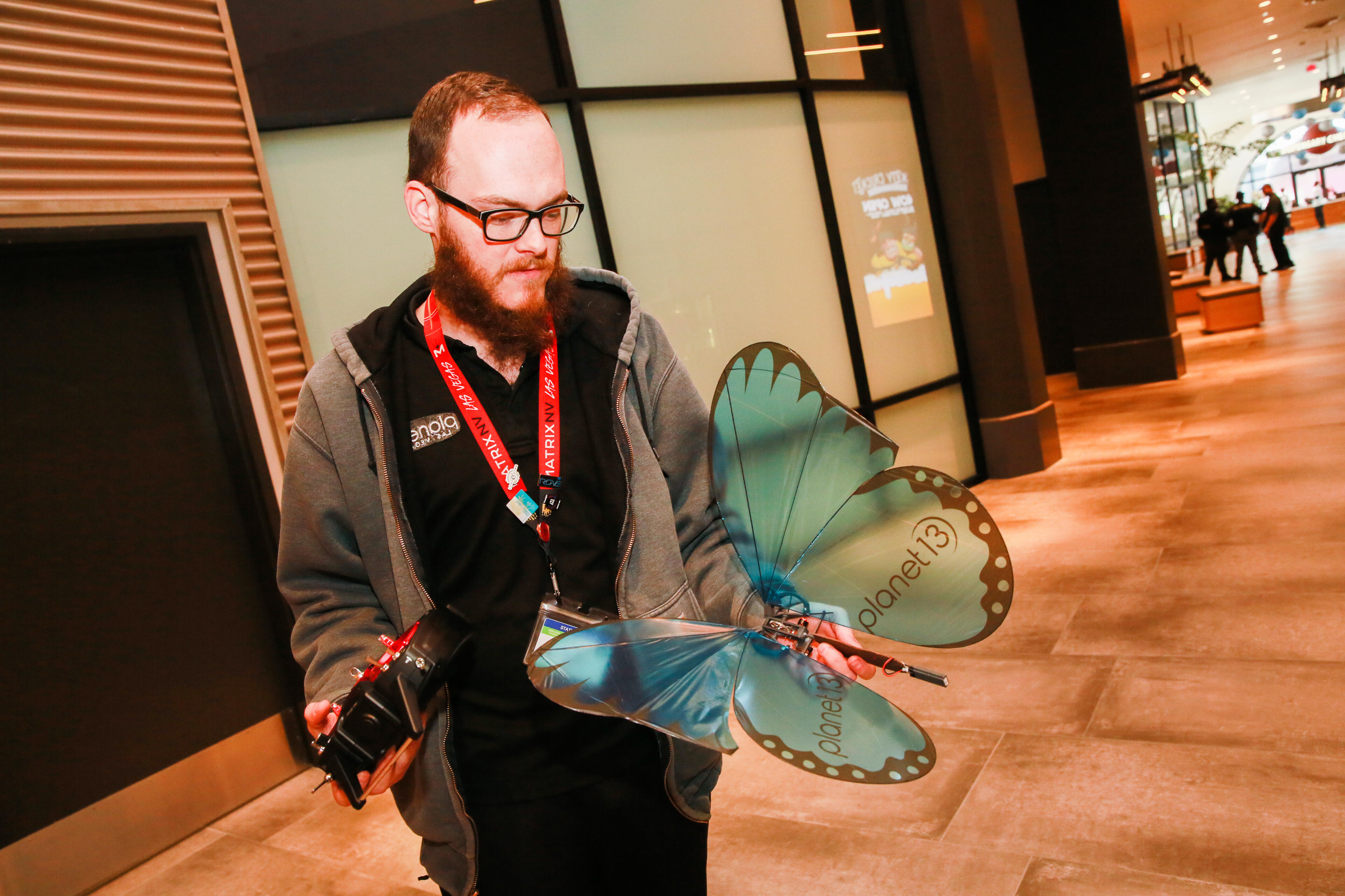 """Known as """"the drone guy,"""" this staff member's job is to run a butterfly drone over the lobby at half-past the hour throughout the day."""