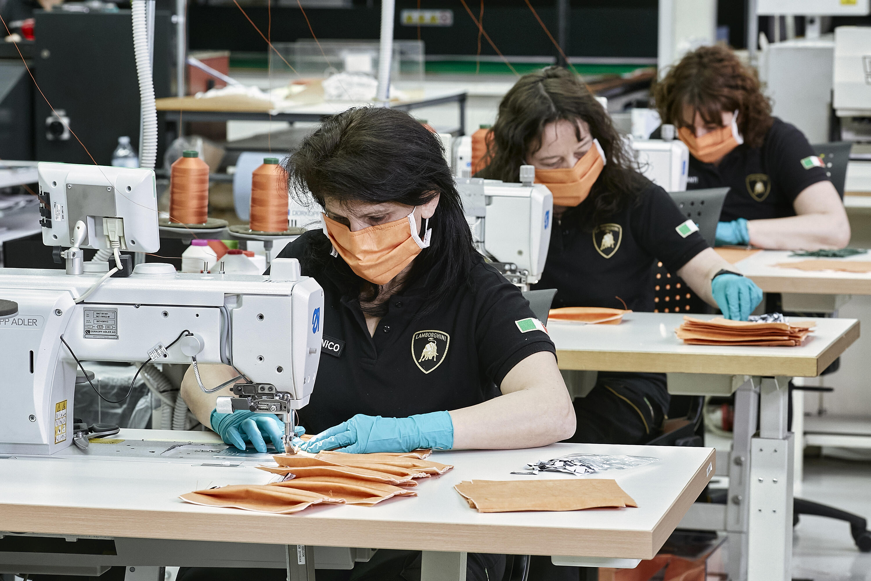 Lamborghini workers make face masks for health care workers
