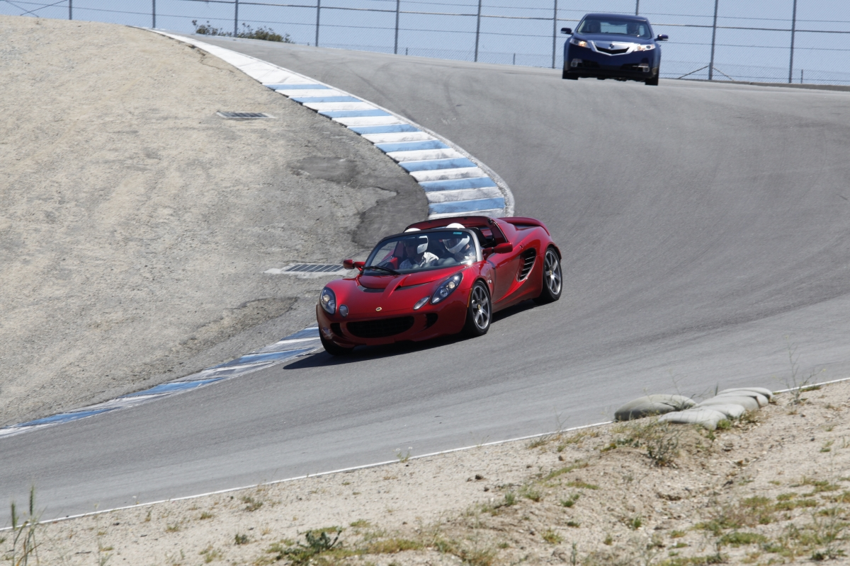 A Lotus and Acura on the track at Laguna Seca