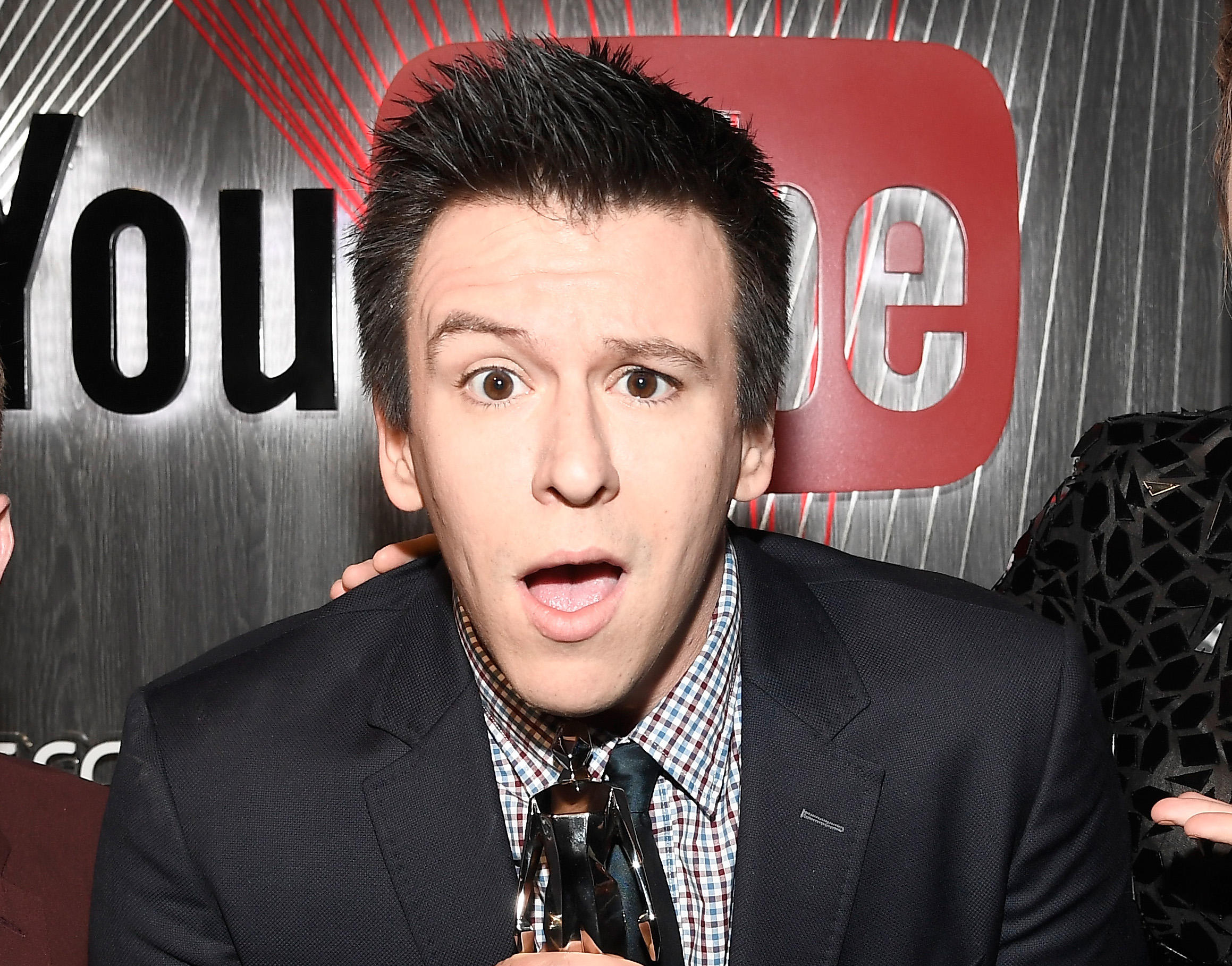 Phil DeFranco arches his eyebrow while looking surprised into the camera