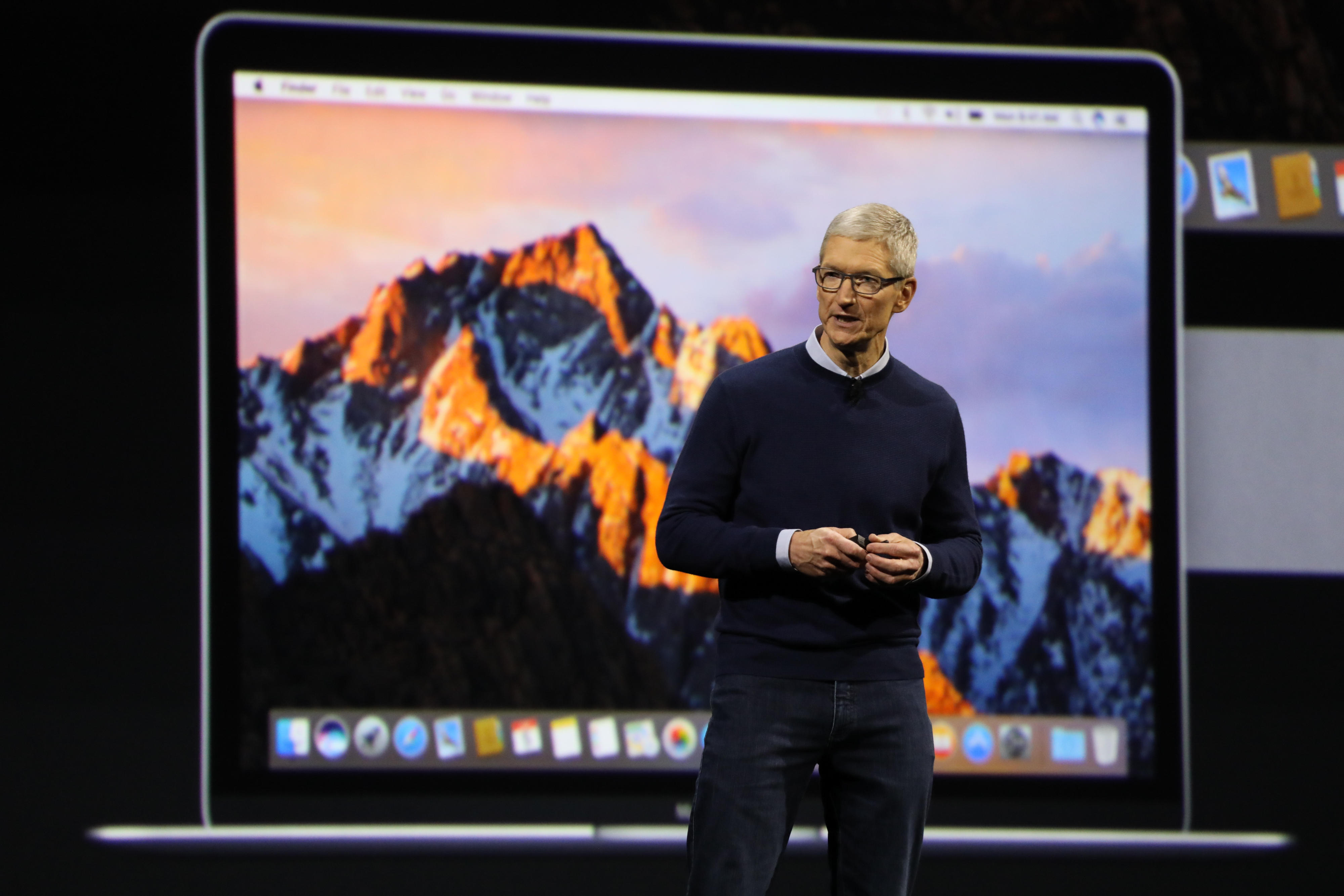Tim Cook stands onstage at Apple's annual developer conference in 2017. On Wednesday, the company patched the Sierra and El Capitan operating systems against the Meltdown security flaw.