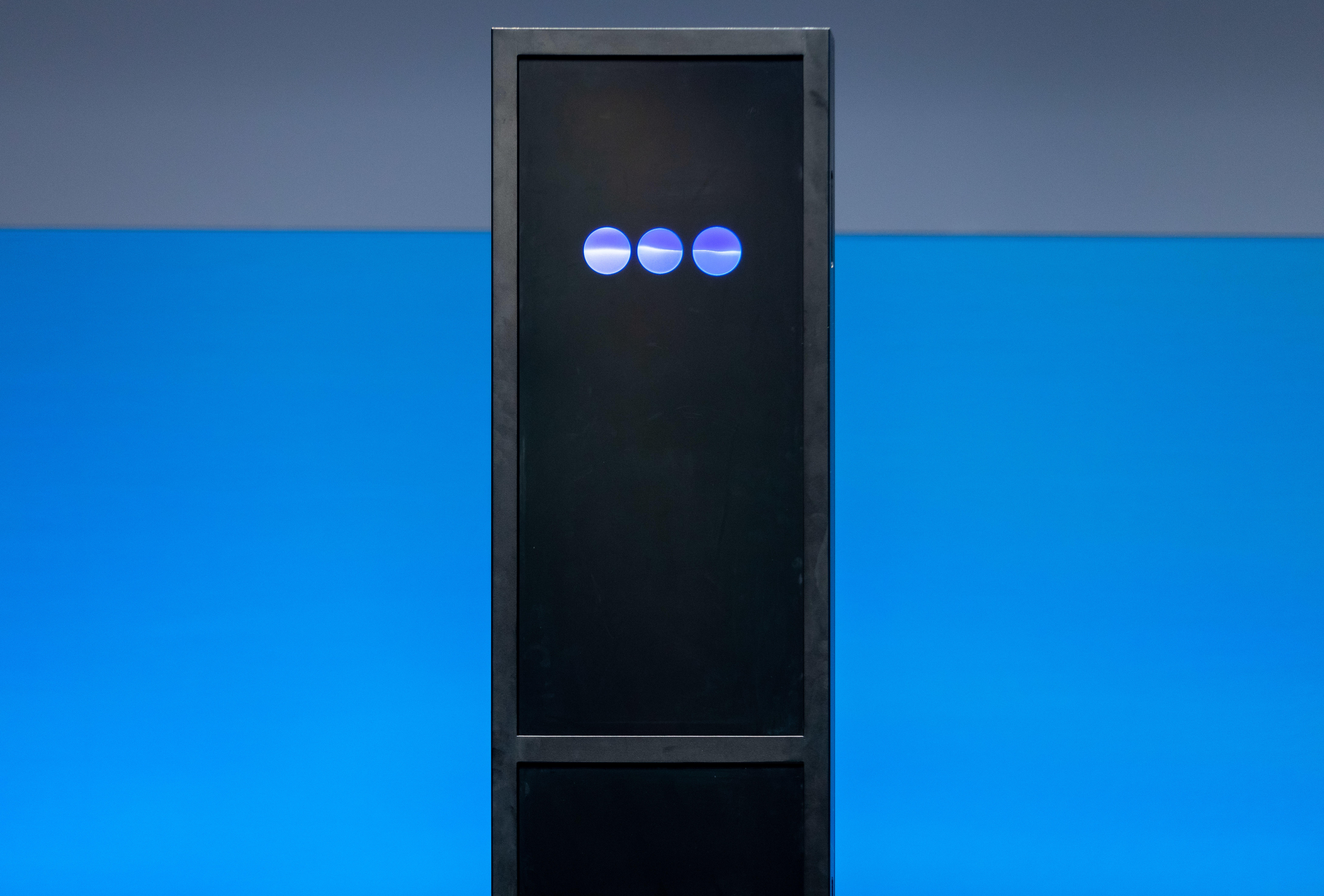 IBM Debater looks somewhat like the alien monolith in 2001: A Space Odyssey, only with animated bouncing blue circles to denote activity. Behind the scenes, Debater uses a group of powerful machines on IBM's cloud-computing infrastructure.