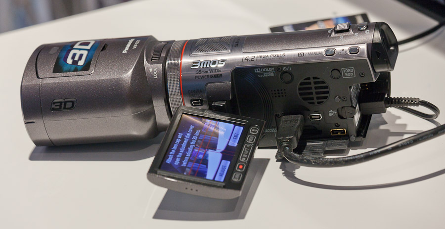 Panasonic's 3D-capable camcorder, shown here with its detachable 3D lens module, can show dual images on its screen.