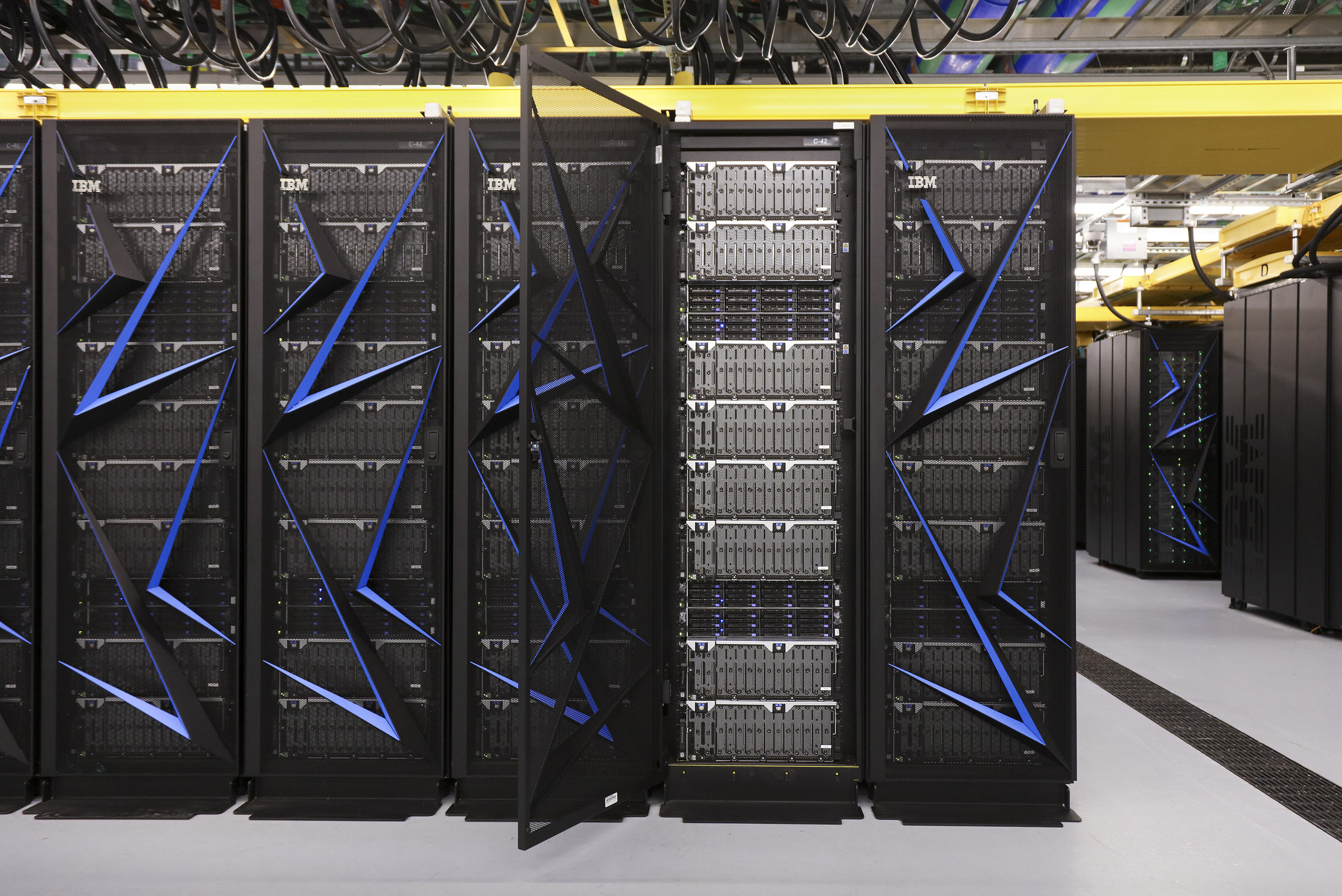 Some of the racks of computer nodes that make up the Summit supercomputer built by IBM at Oak Ridge National Laboratory in Tennessee.