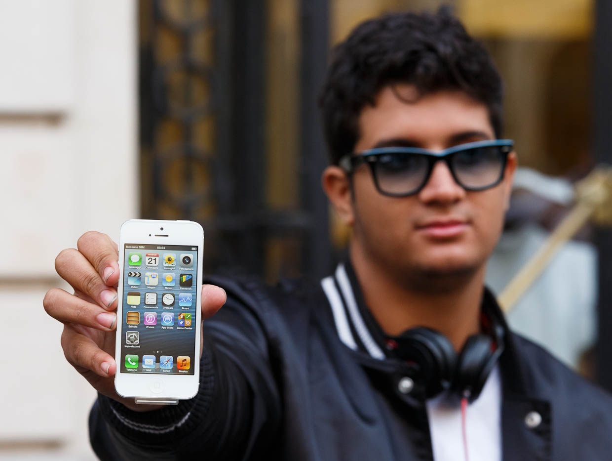 Anthony Fitch holds the first iPhone 5sold at Apple's store near Paris' Opera house. He waited in line about 40 hours to get the phone.