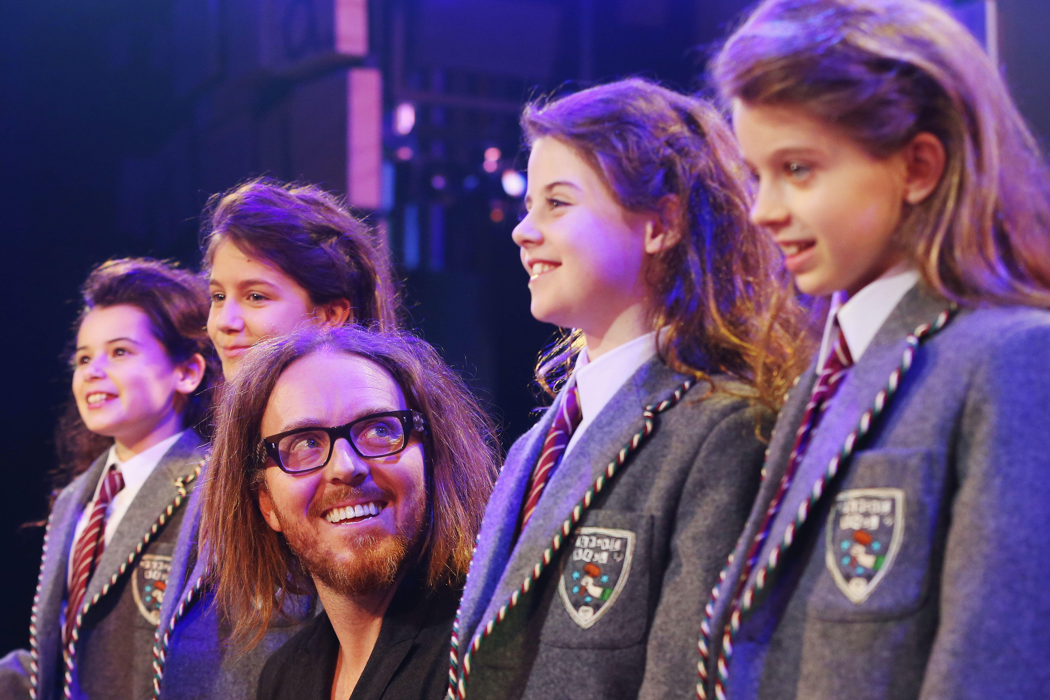 Musical director Tim Minchin poses with the four Matilda cast members (L-R) Dusty Bursill, Tiana Mirra, Alannah Parfett and Ingrid Torelli perform during a media call for Matilda The Musical at Princess Theatre on March 16, 2016 in Melbourne, Australia