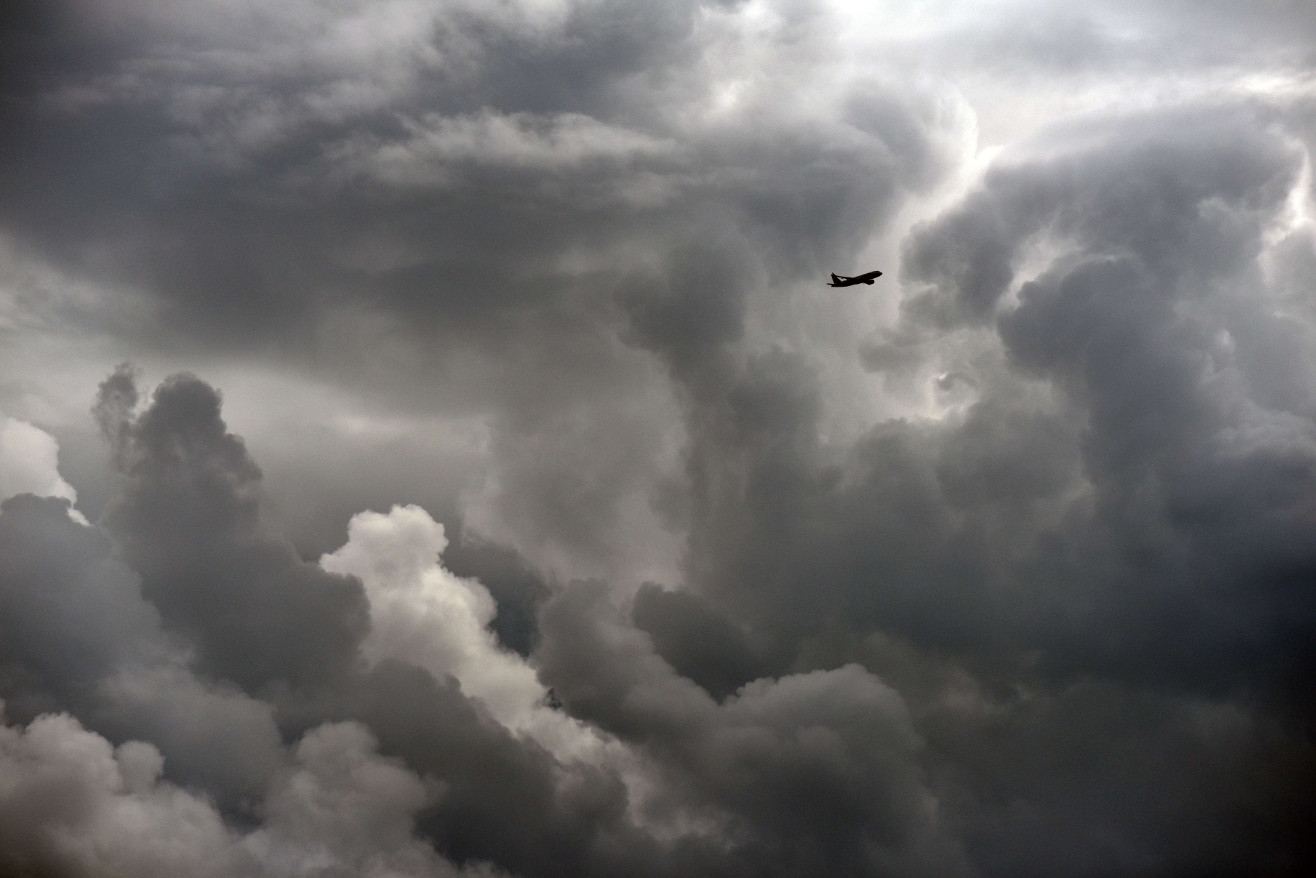 Image of plane in cloudy sky.