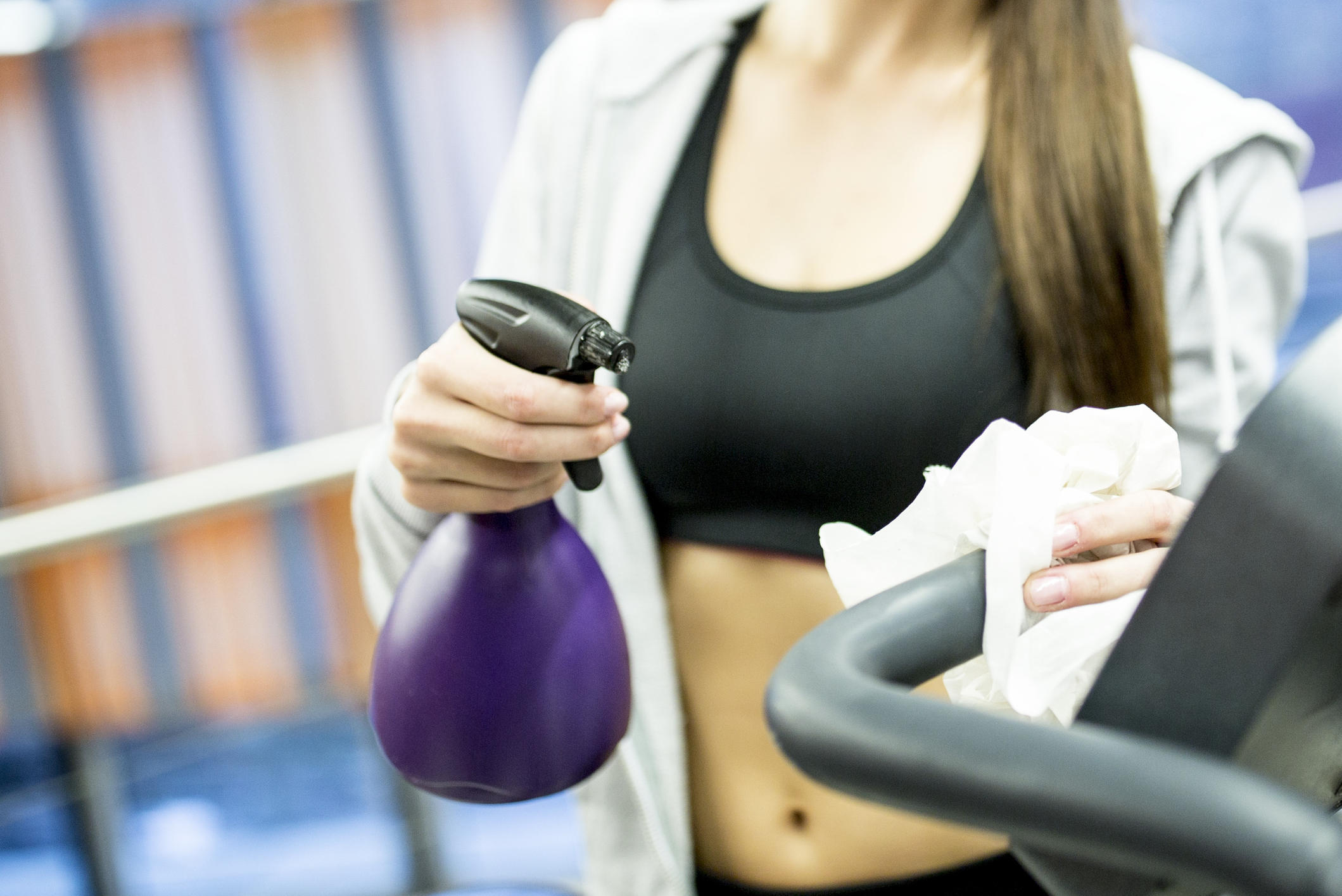 Woman cleaning exercise bike