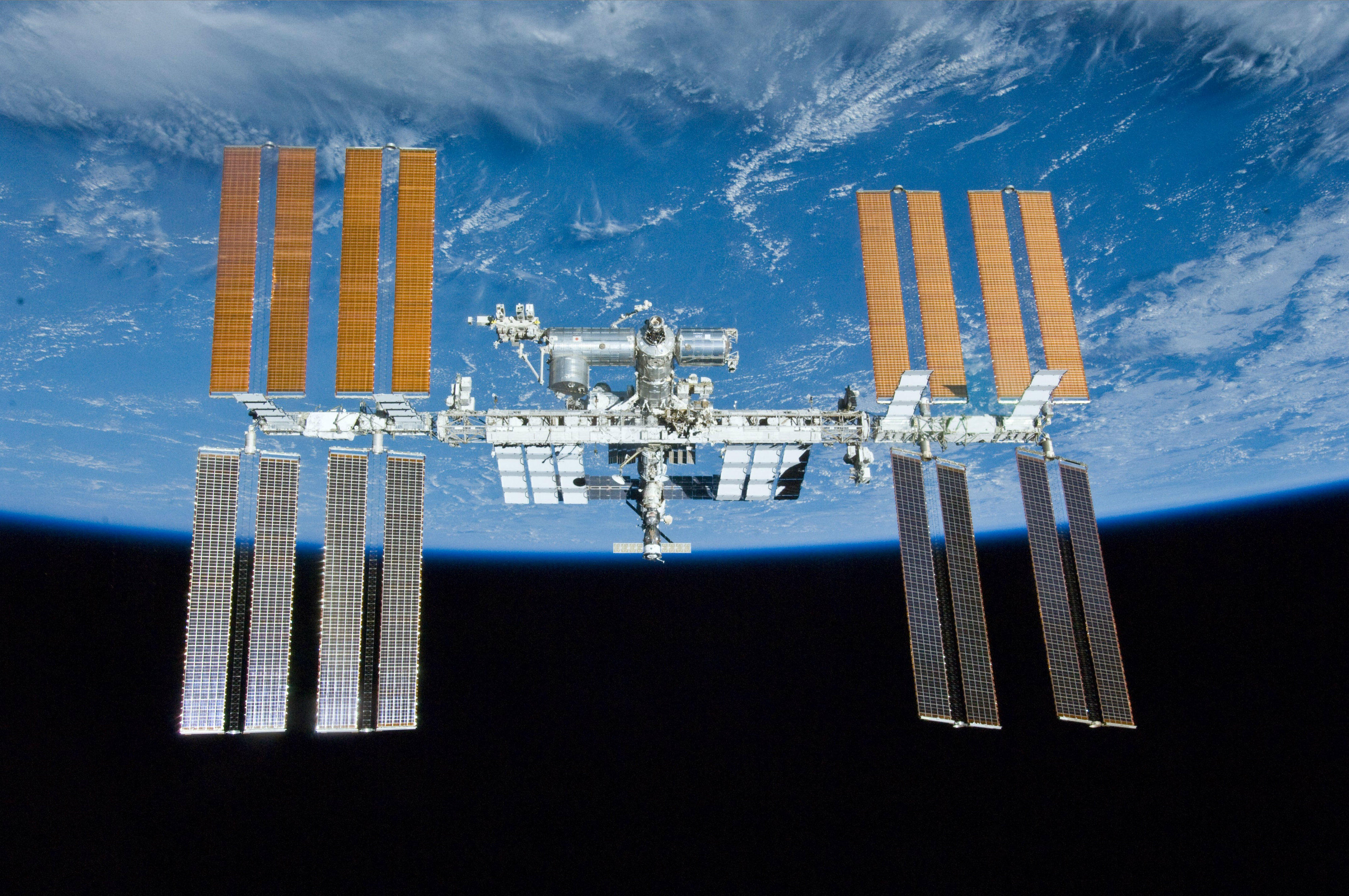 The International Space Station, with Earth in the background.
