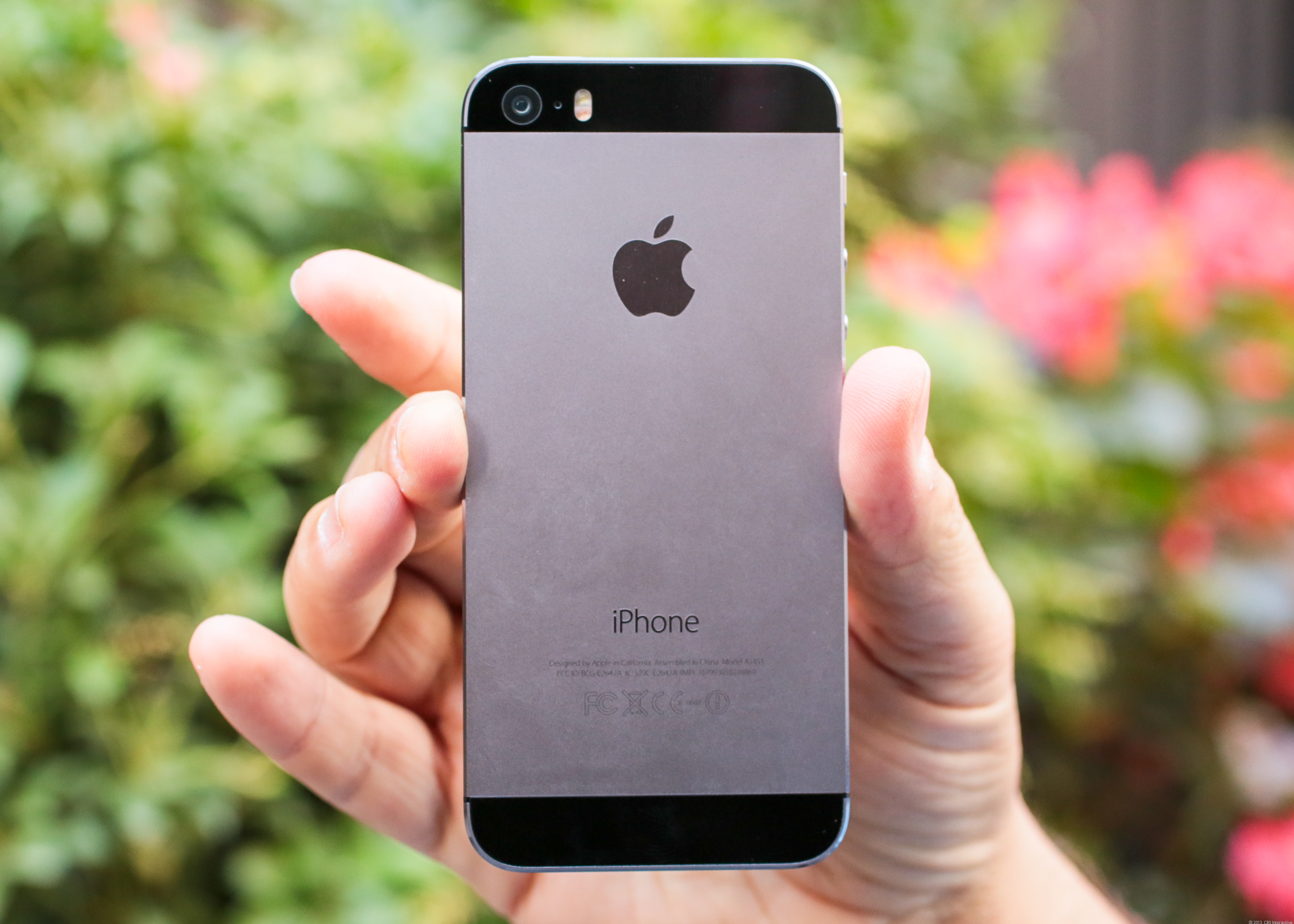 """Apple's new iPhone 5S, in the """"space gray"""" color."""