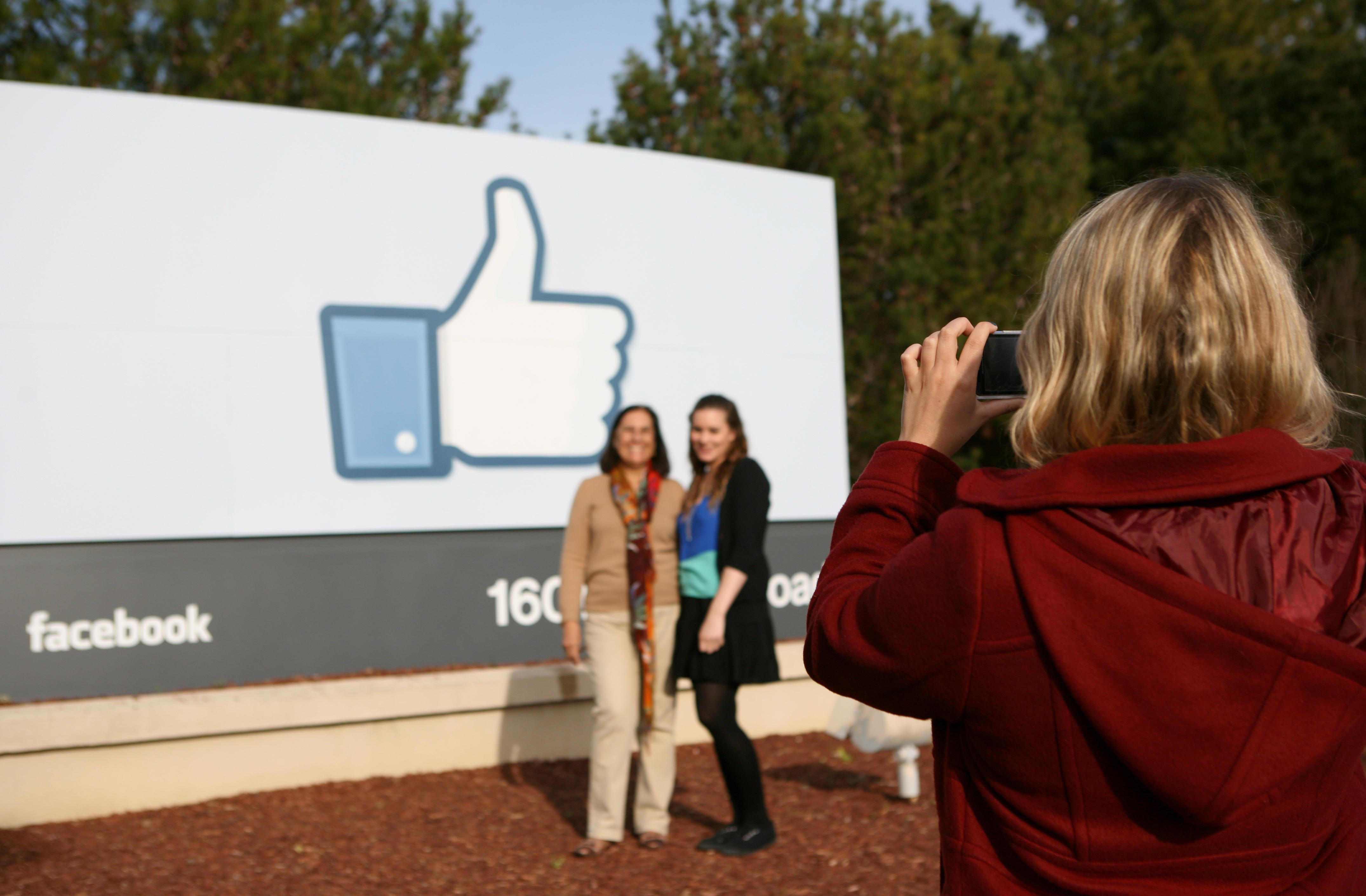 Visitors of Facebook take a pose in fron